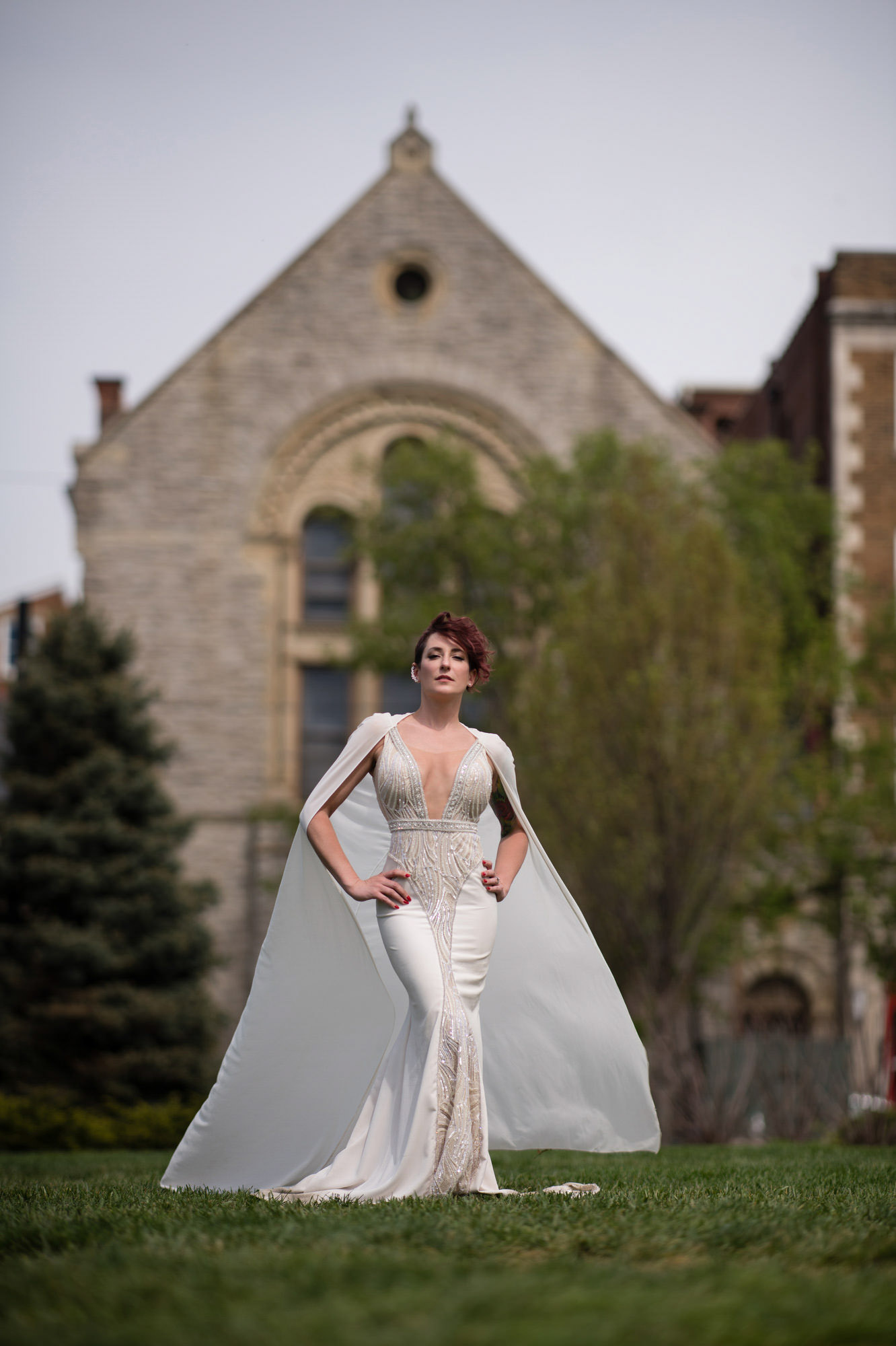 Fashionable bride in plunging silk trumpet gown - photo by Jerry Ghionis