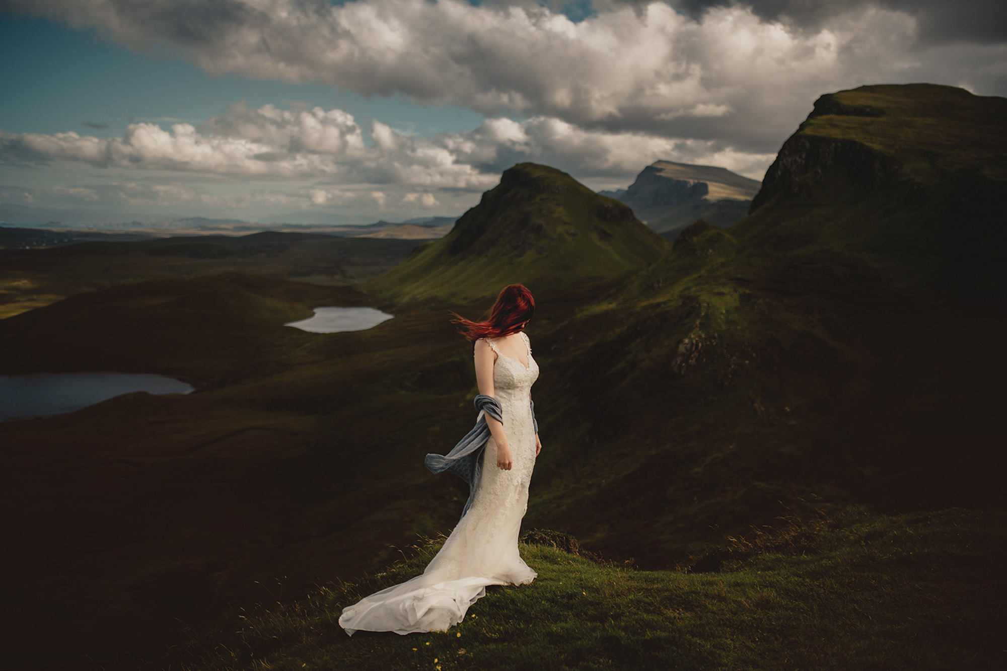 Red-haired bride in mountain landscape - photo by McClintock Photography Agency