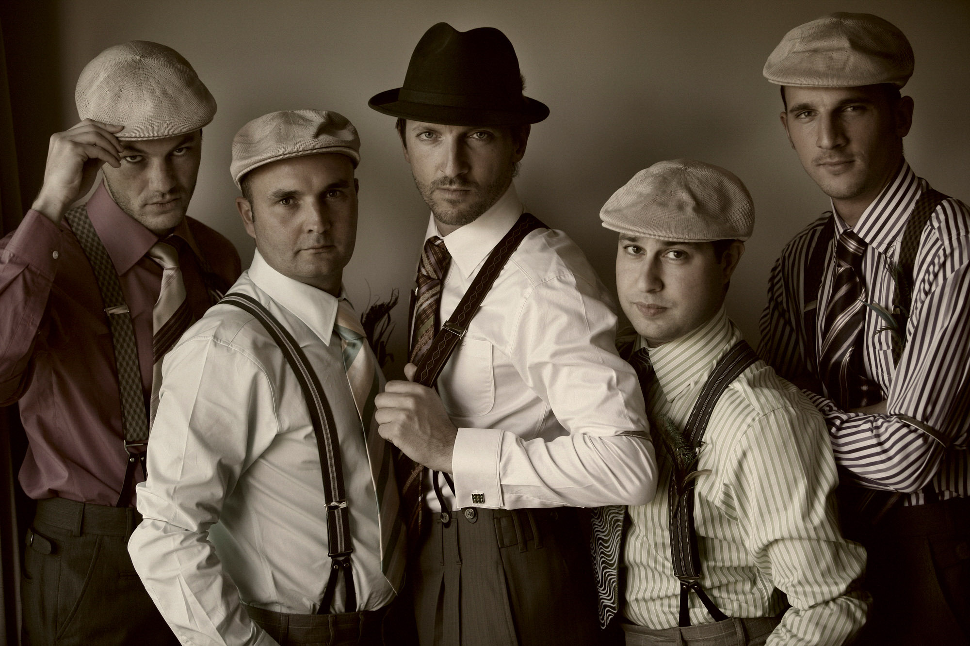 Retro group shot of groom and groomsment  by Jerry Ghionis luxury wedding photographer