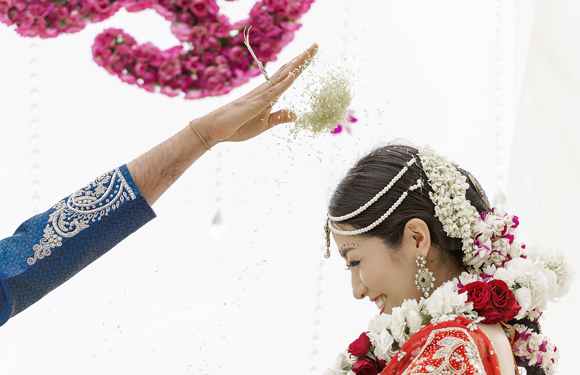 Rice thrown on bride's head during ceremony - photo by 37 Frames - Japan