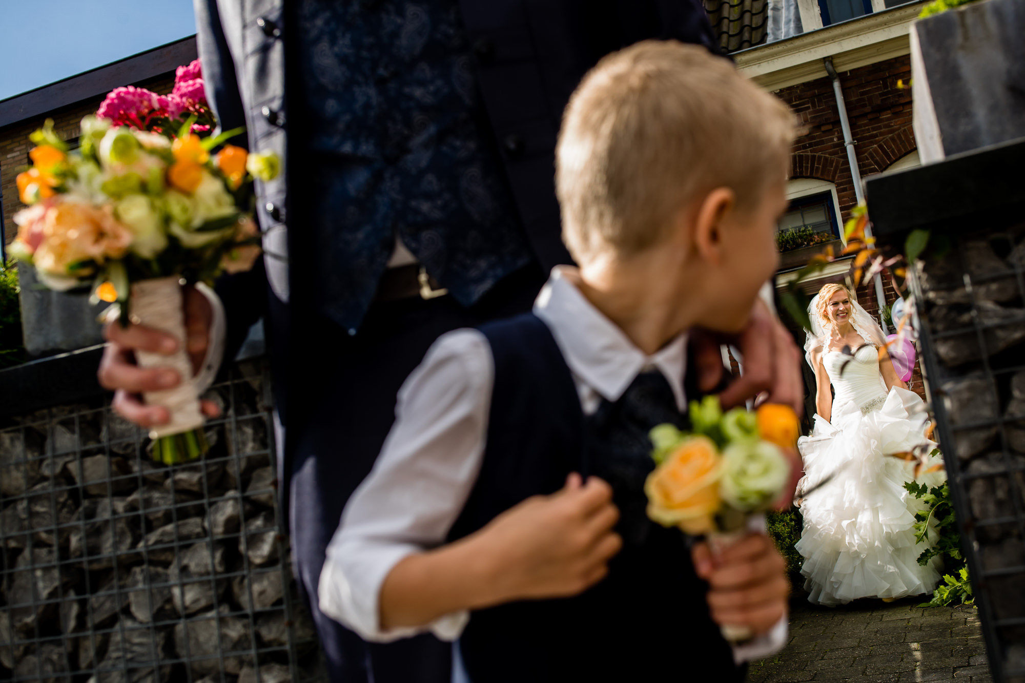 Ring bearer looks back at bride photo by Eppel photography