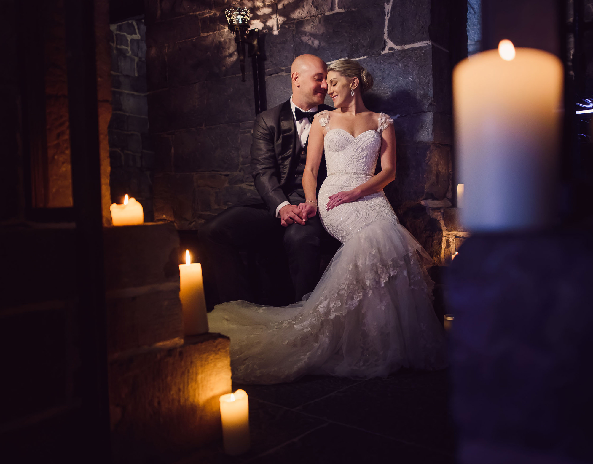 Elegant portrait of couple on candlelit stairs - photo by The Brenizers - NYC