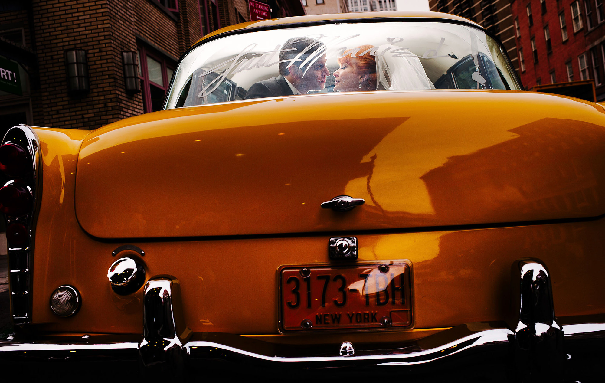 Couple kissing in window of gold car - photo by The Brenizers - NYC