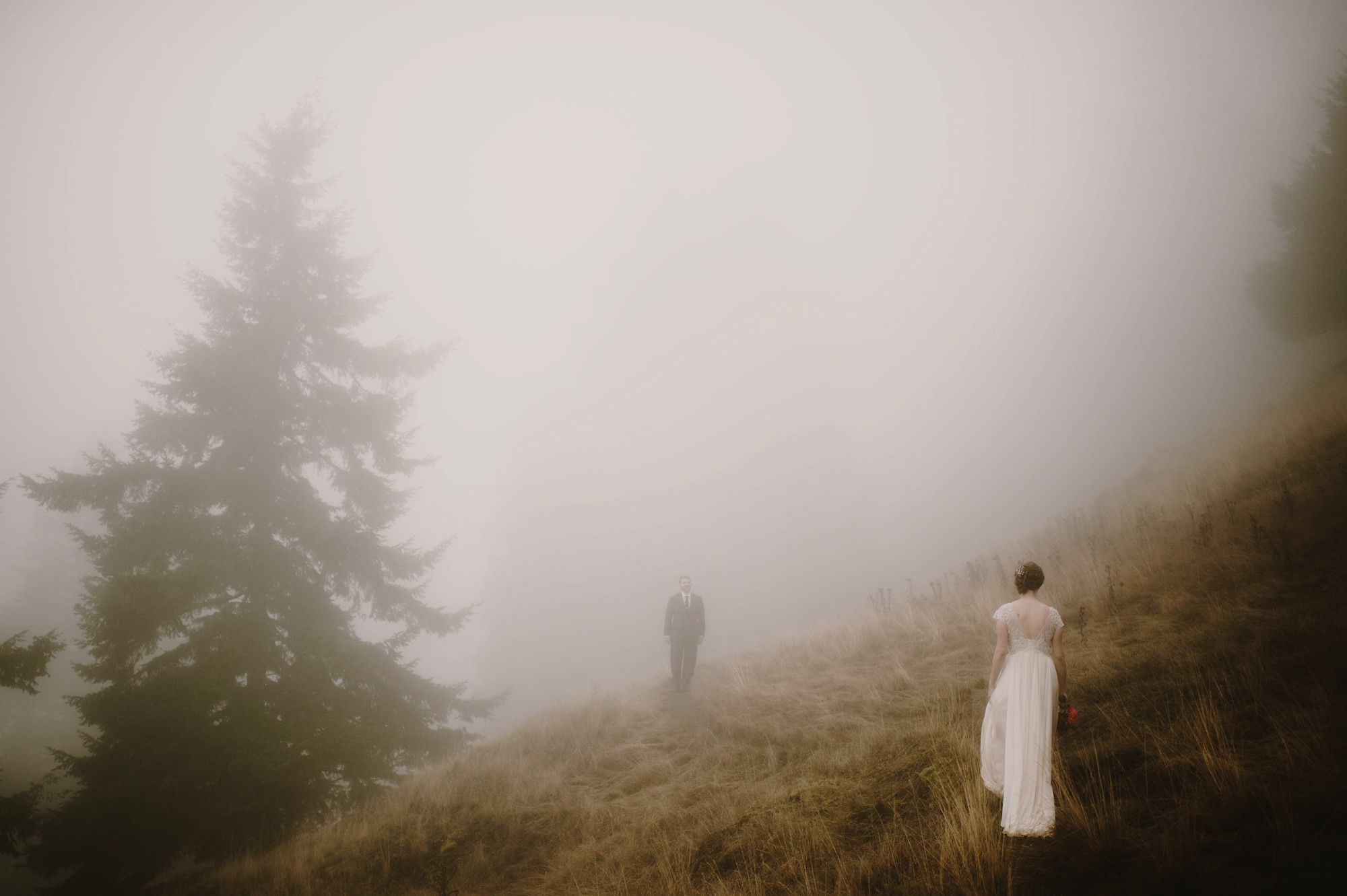 Romantic first look through fog - photo by Kristen Marie Parker
