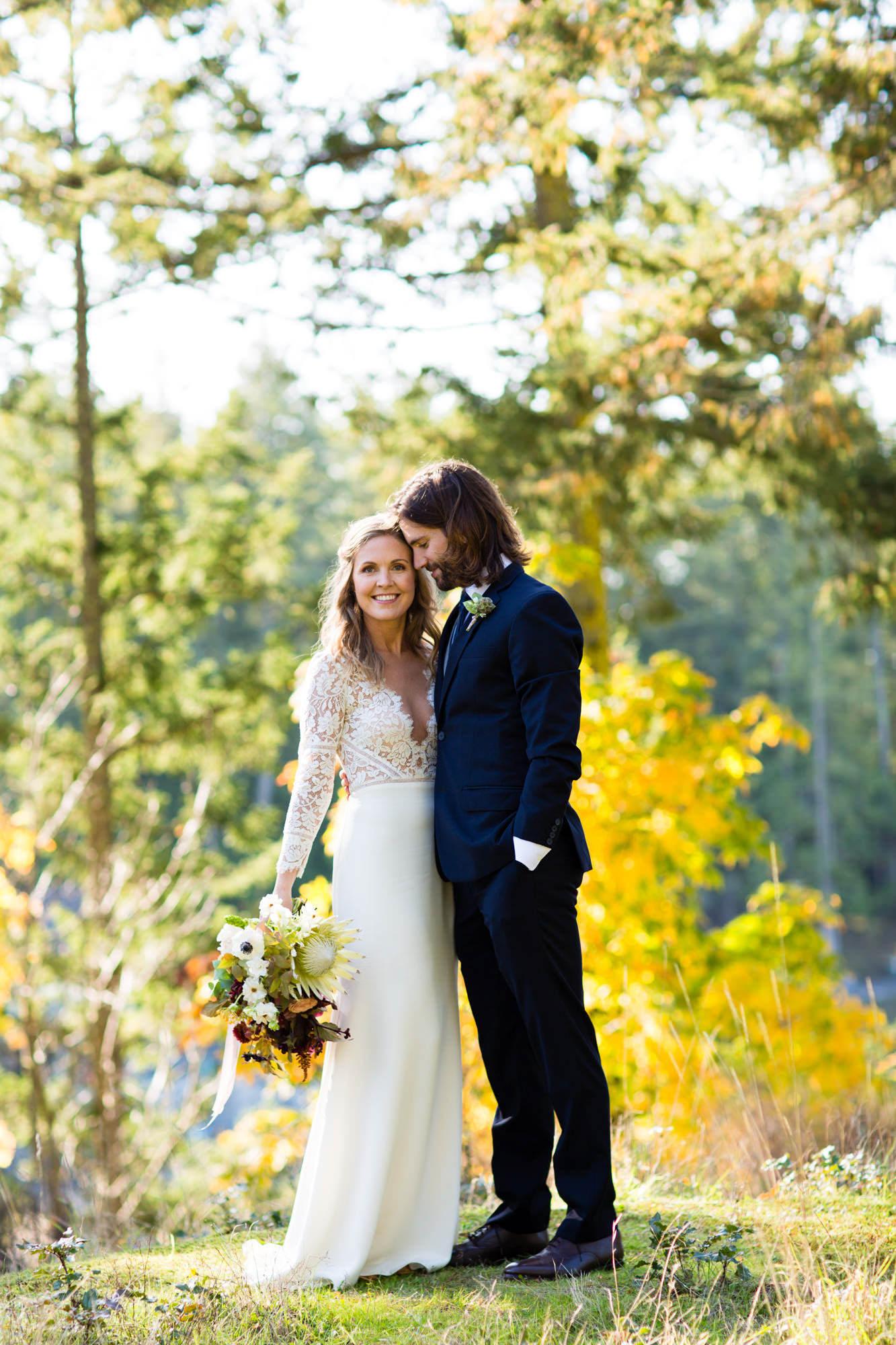 Couple portrait with bride holding summer bouquet - La Vie Photography