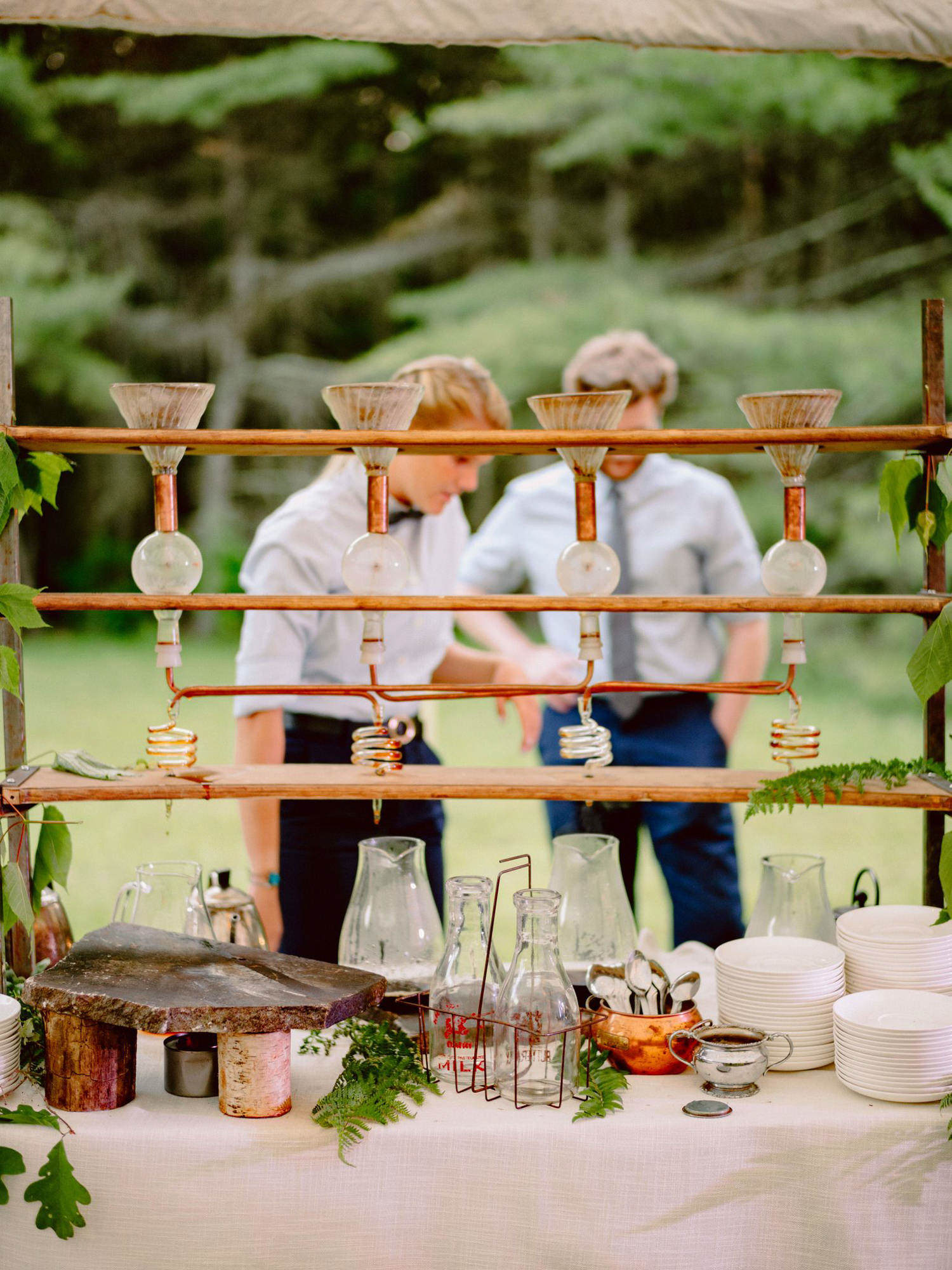 Rustic wedding buffet with vintage glass - Photo by Benj Haisch