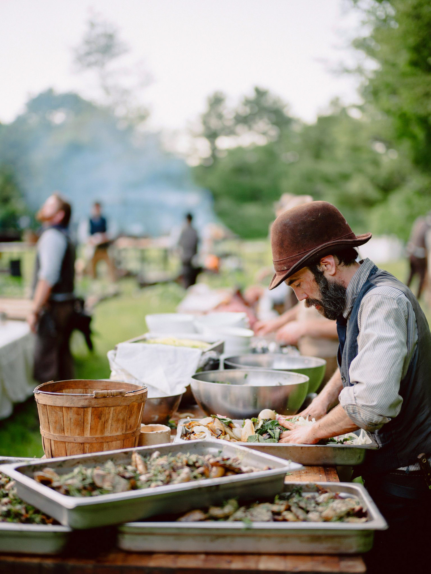 Campout cooking at rustic wedding - photo by Benj Haisch