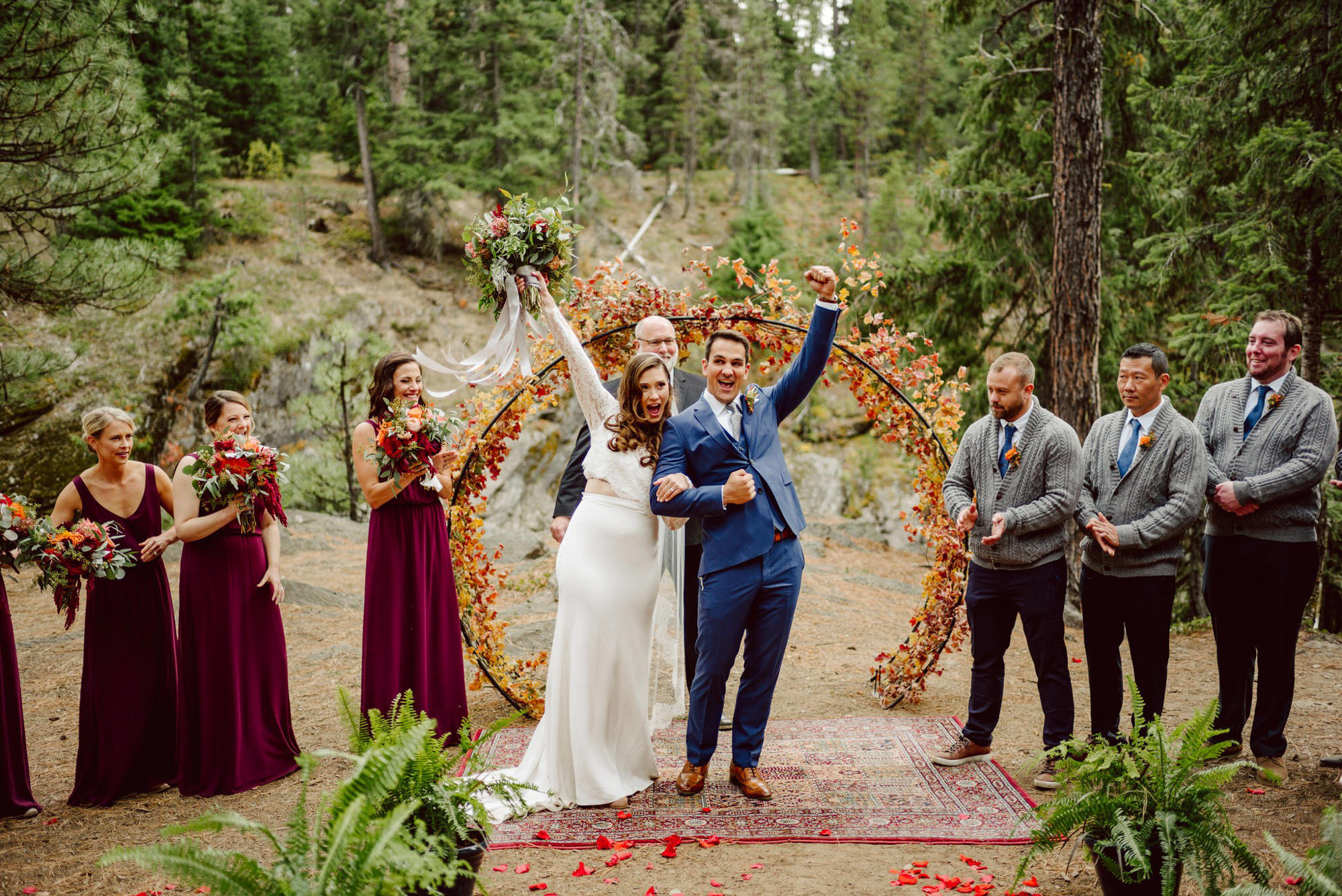 Just married couple celebrating at forest ceremony - Photo by Benj Haisch