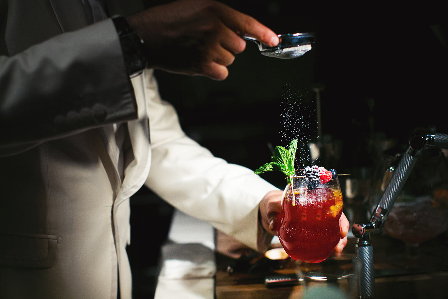Bartender making a sangria cocktail, by Callaway Gable