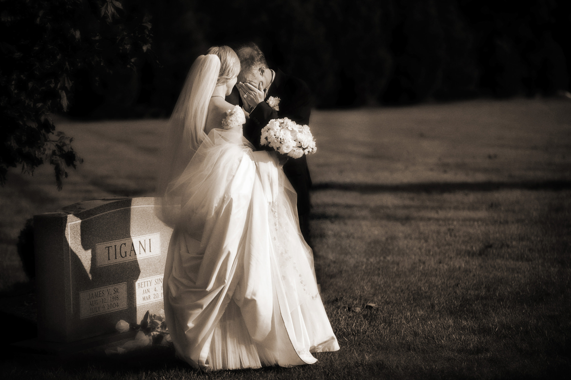 Sepia bride and groom crying at cemetery photo by Cliff Mautner
