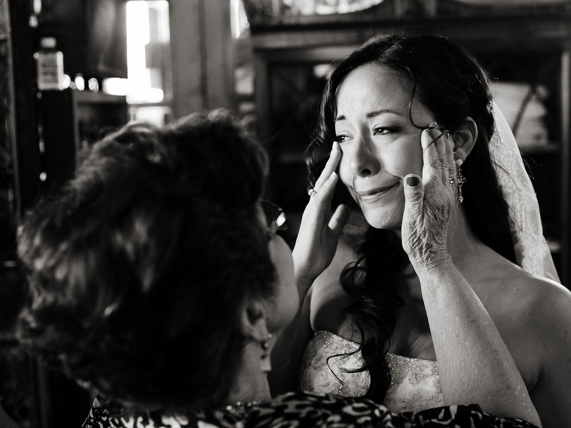 Bride holding crying brides face - photo by The Brenizers - NYC