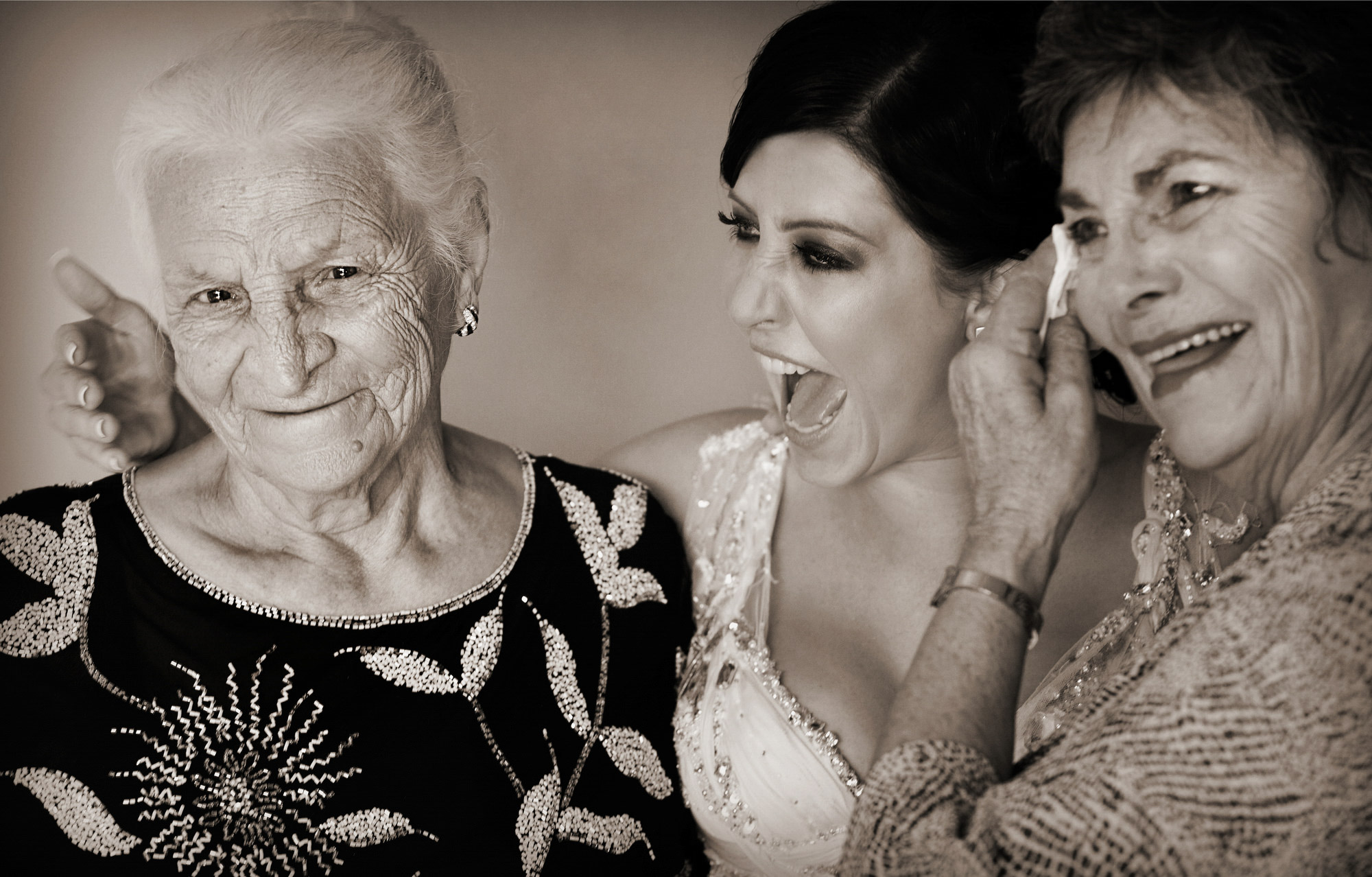 Sweet moment with 3 generations - family portrait by Jerry Ghionis