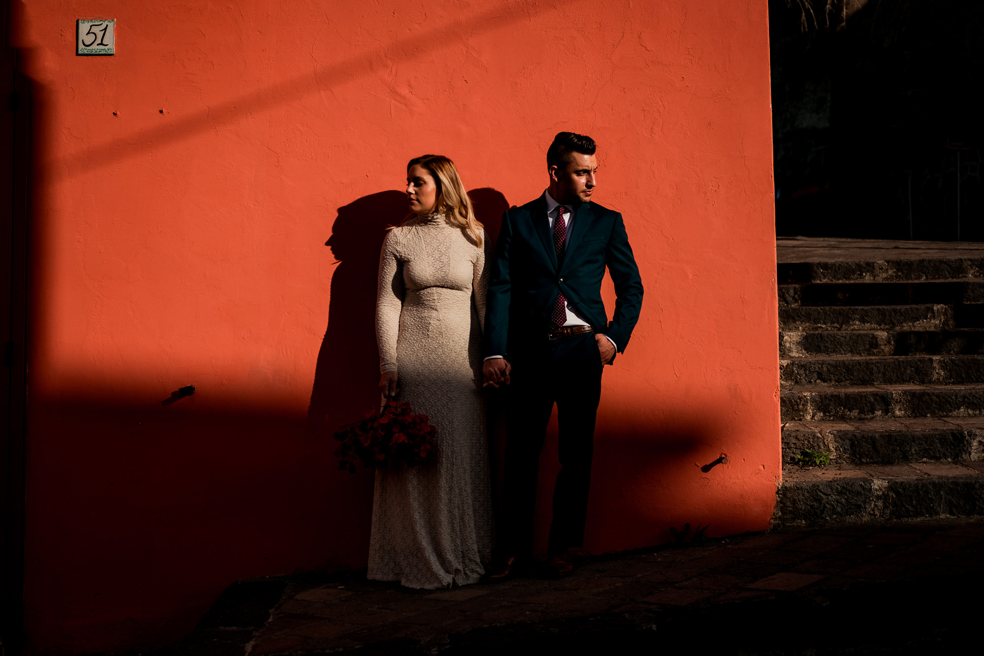 Serious couple strikes a pose photo by Nordica Photography