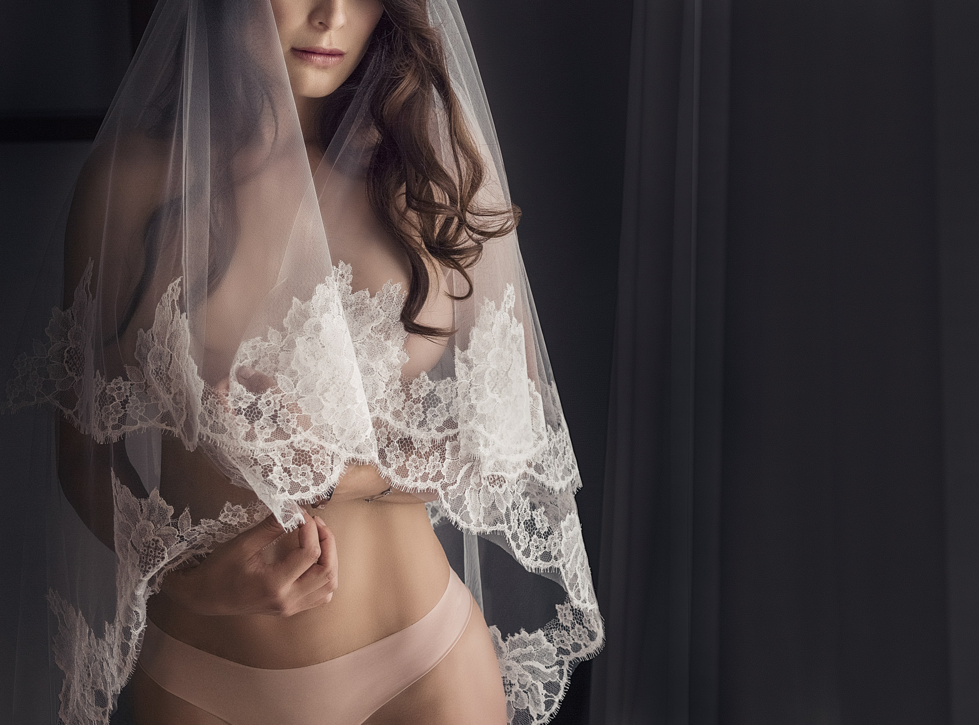 Sexy photo of topless bride with covering mantilla veil by Roberto Valenzuela
