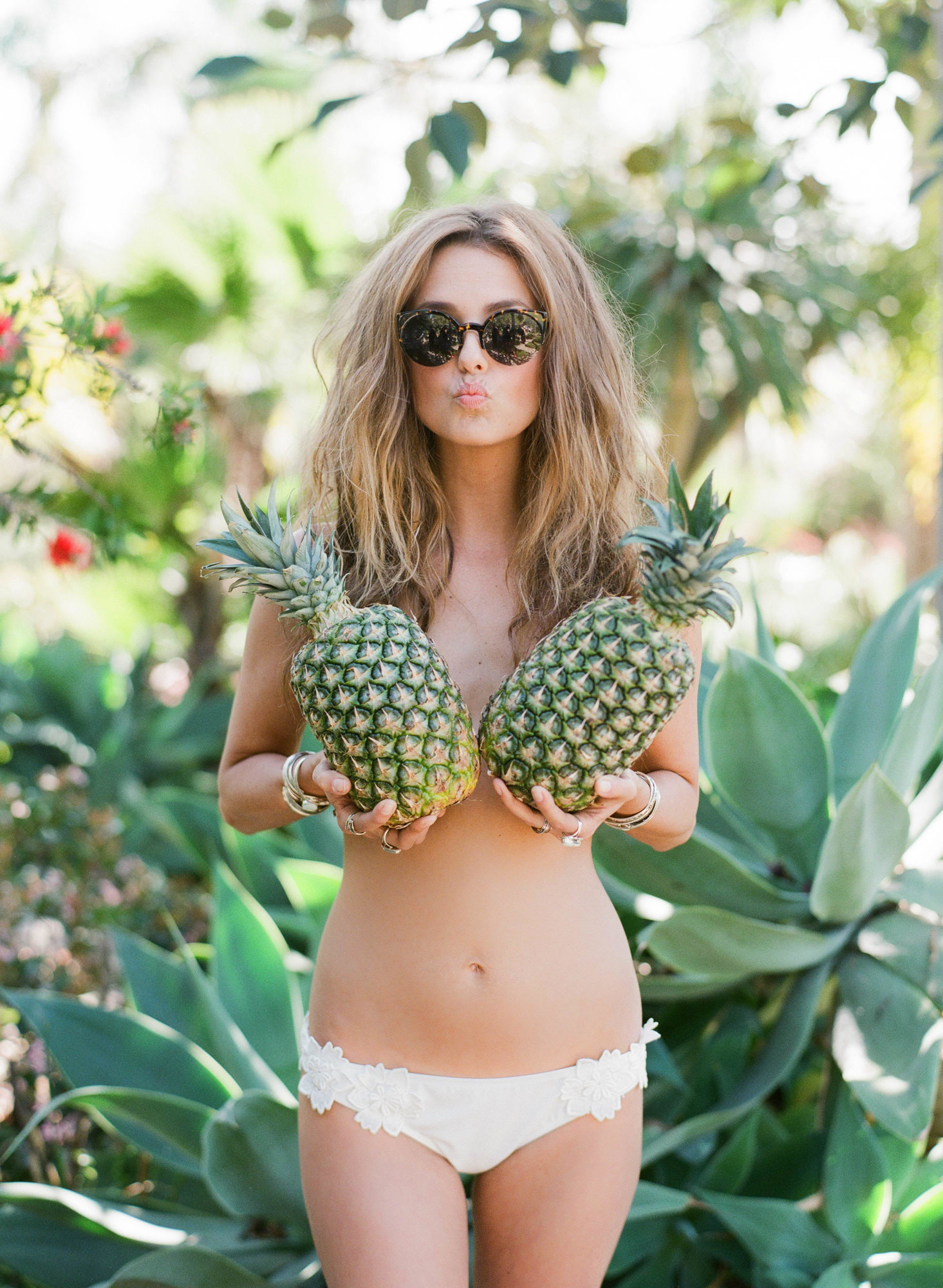 Funny and sexy portrait of bride holding pineapples - Greg Finck Photography