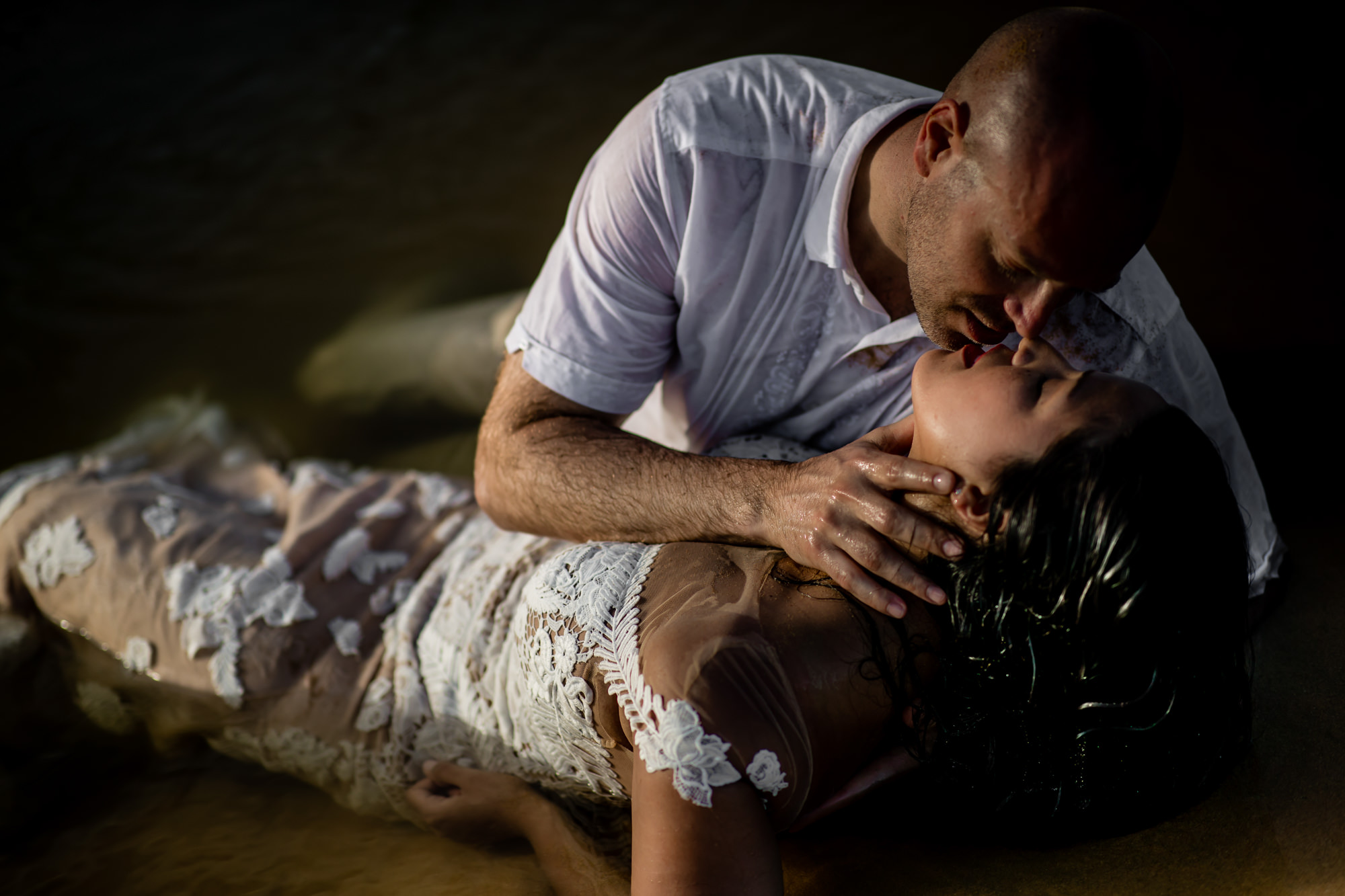 sexy photo of bride and groom kissing on the beach by Eppel Photography