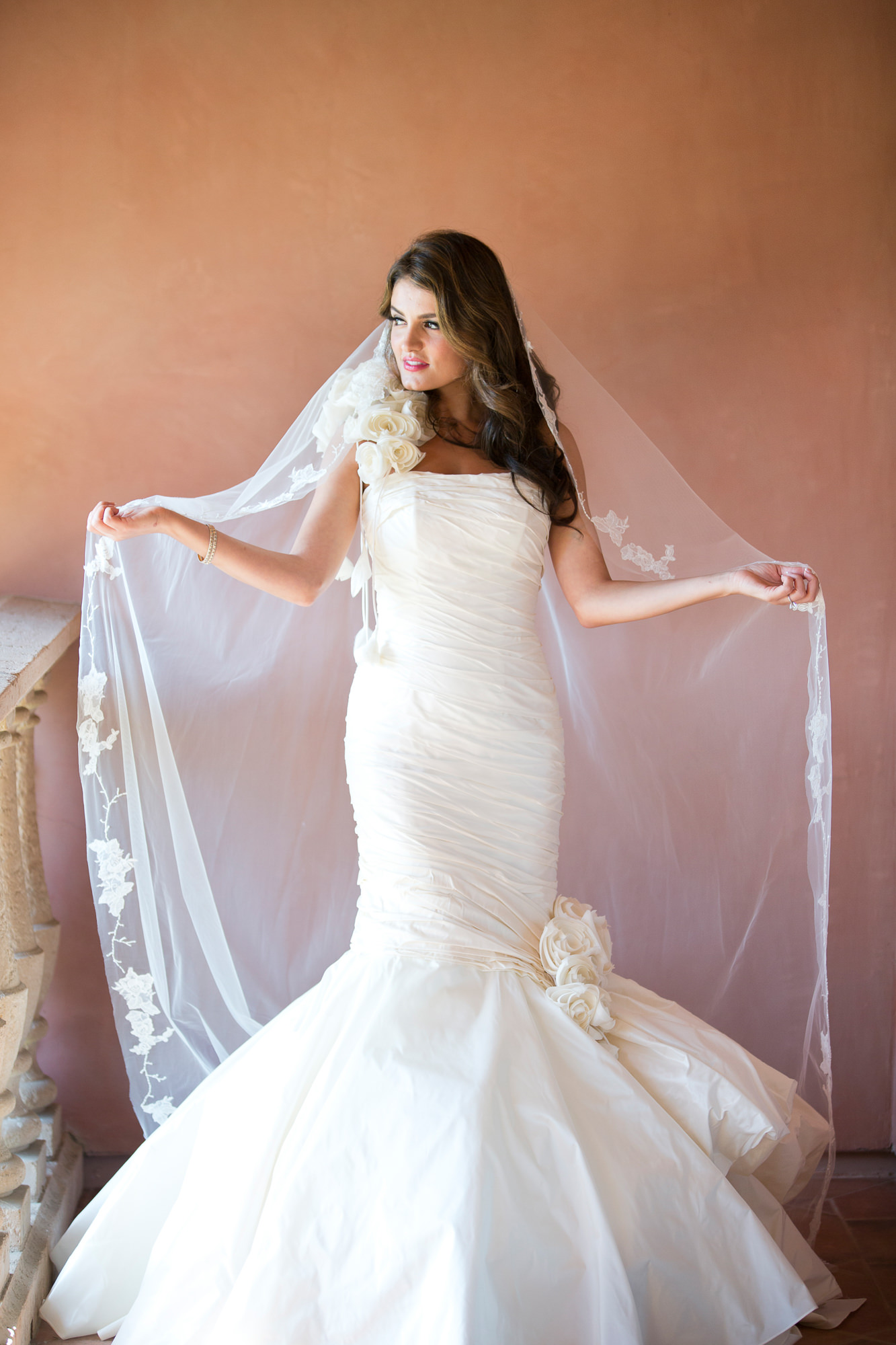 Bride in strapless trump gown and mantiall veil- photo by Roberto Valenzuela