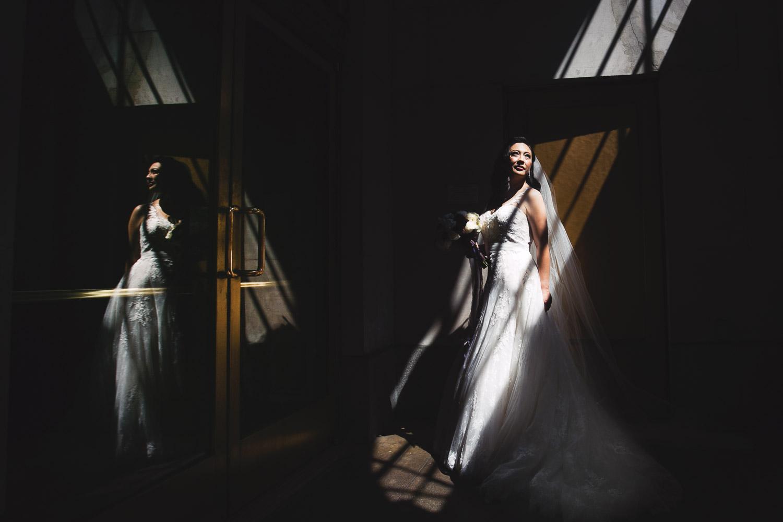 Bridal portrait in dramatic skylight, by Callaway Gable