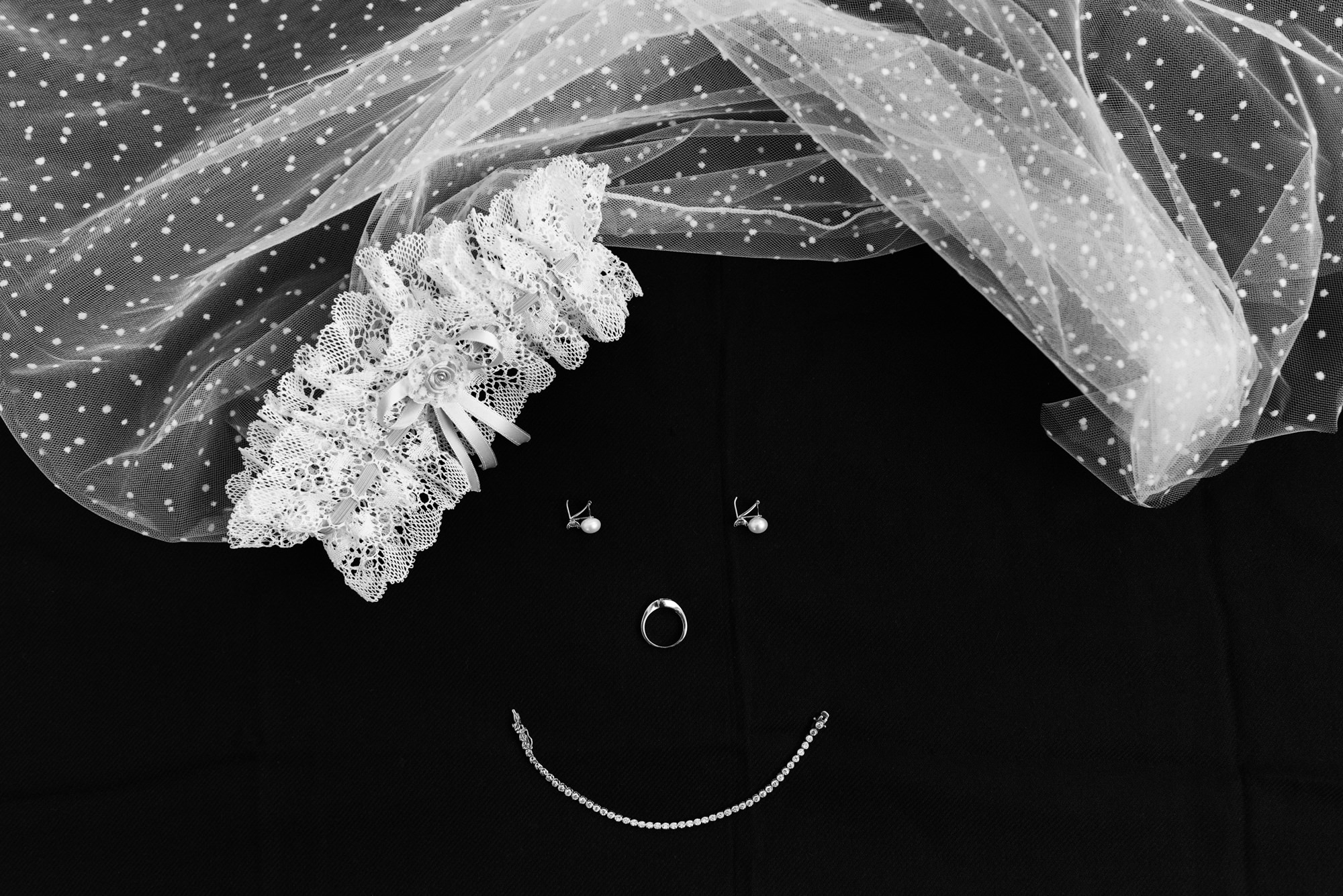 Smiley face wedding jewelry veil - photo by Look Fotographica