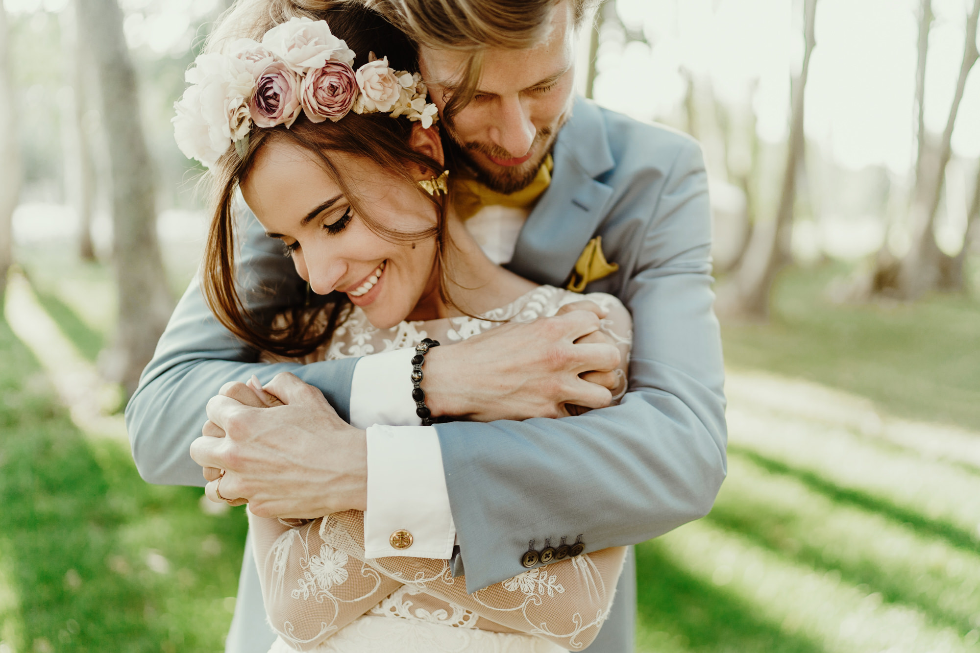 Sweet portrait of groom and bride in rose floral crown by Fer Juaristi