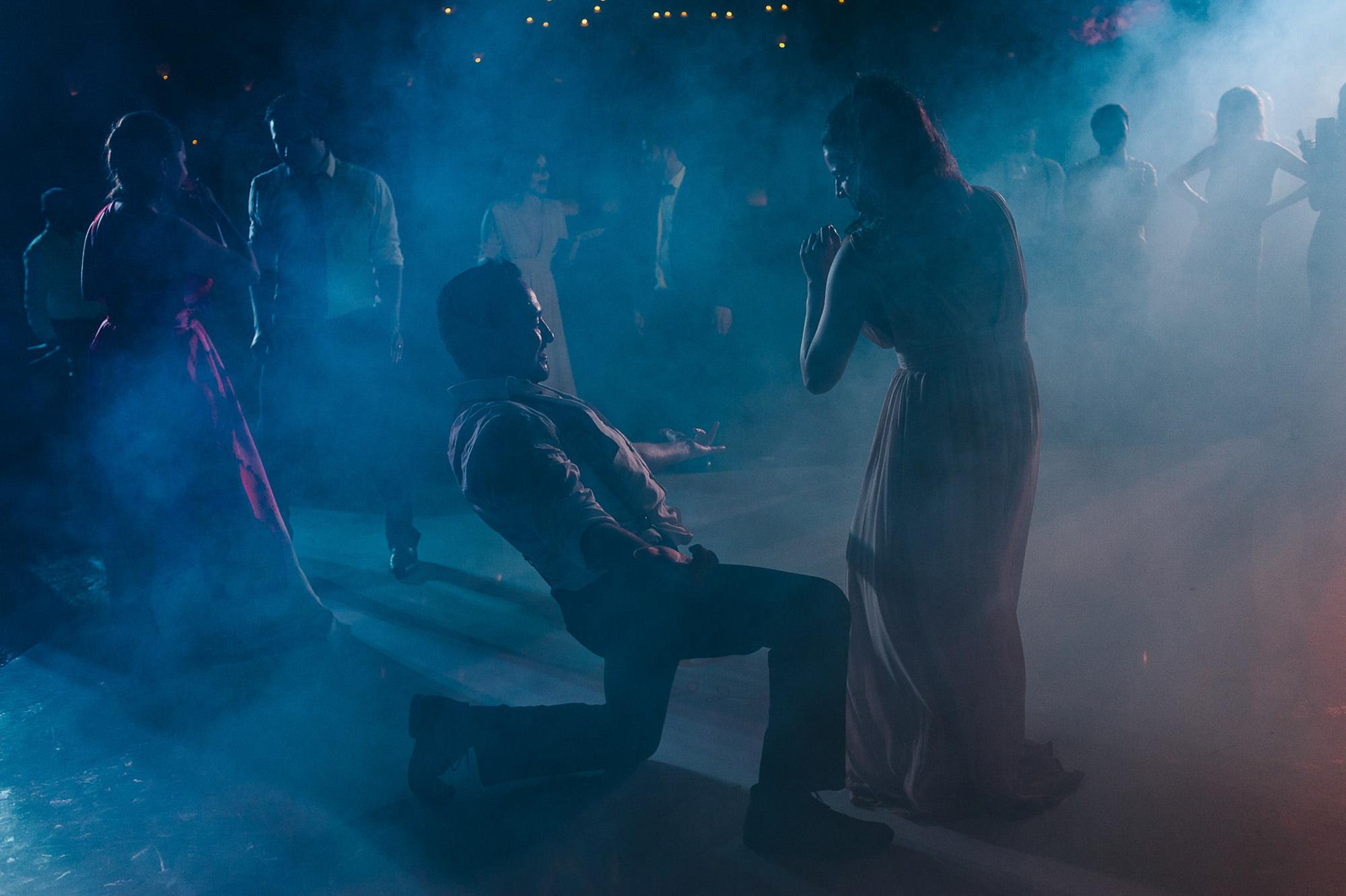 Bride and groom dancing in smoky reception dance floor, by Citlalli Rico