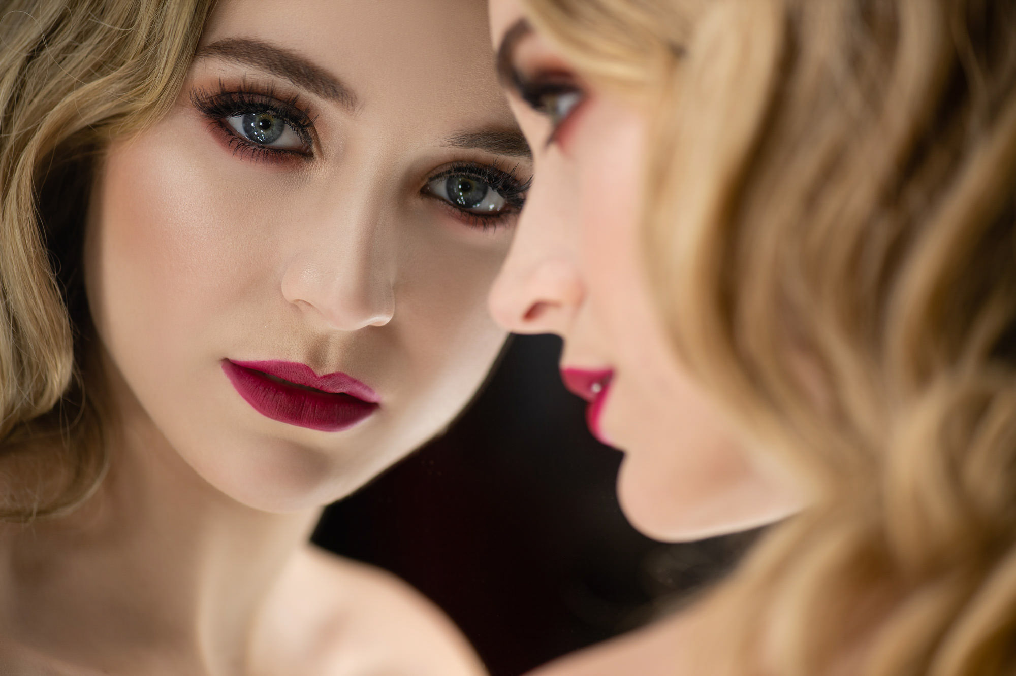 Dramatic bridal makeup - red lips and smoky eyes - photo by Jerry Ghionis luxury wedding photographer