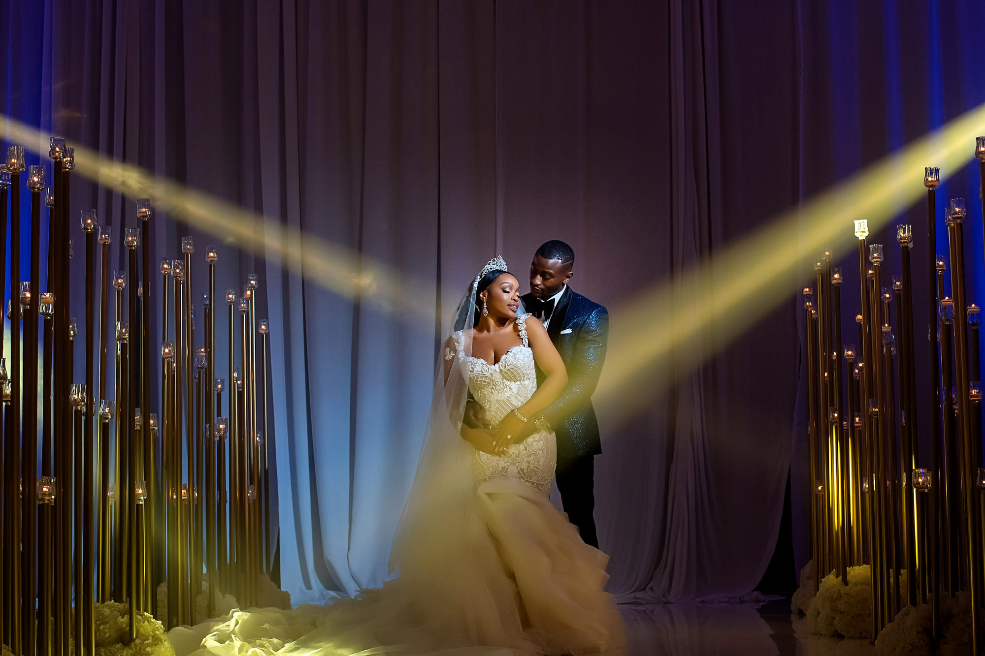 Glamorous couple in spotlights - photo by Alakija Studios