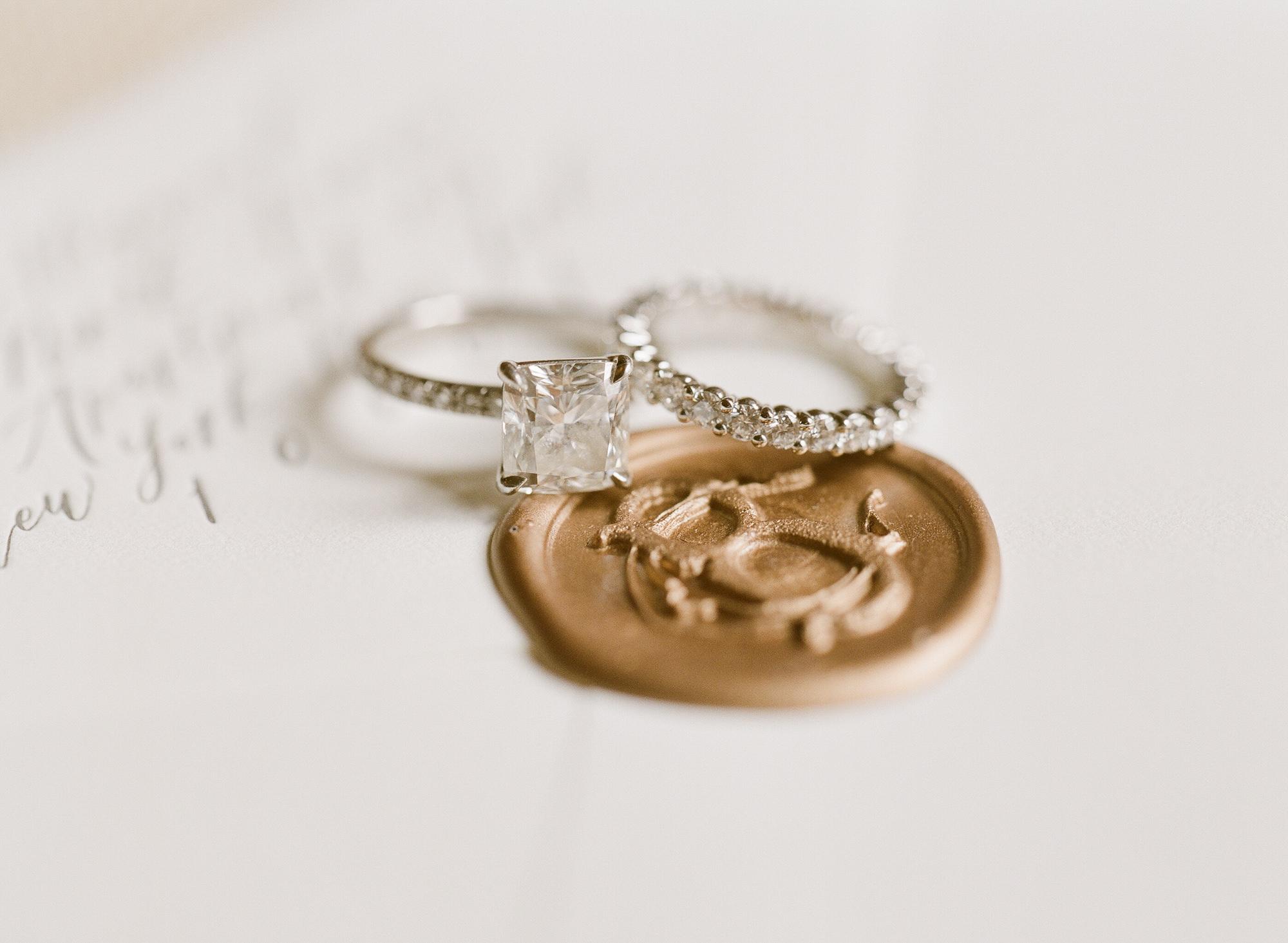 Macro shot of wedding rings on seal, by Greg Finck