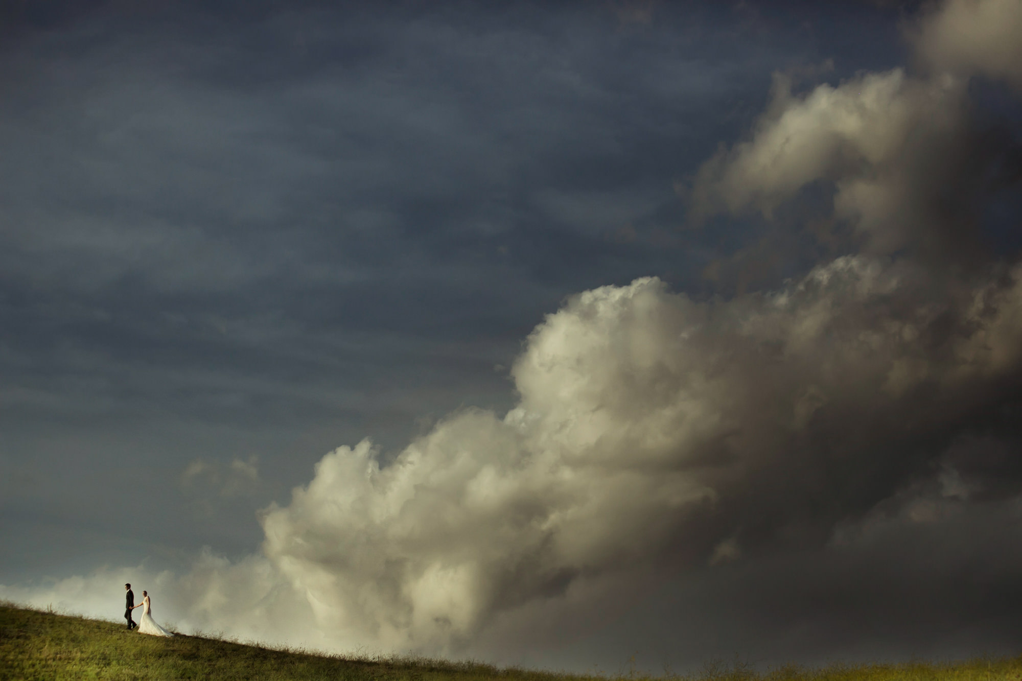Wedding couple in clouds photo by David Bastianoni