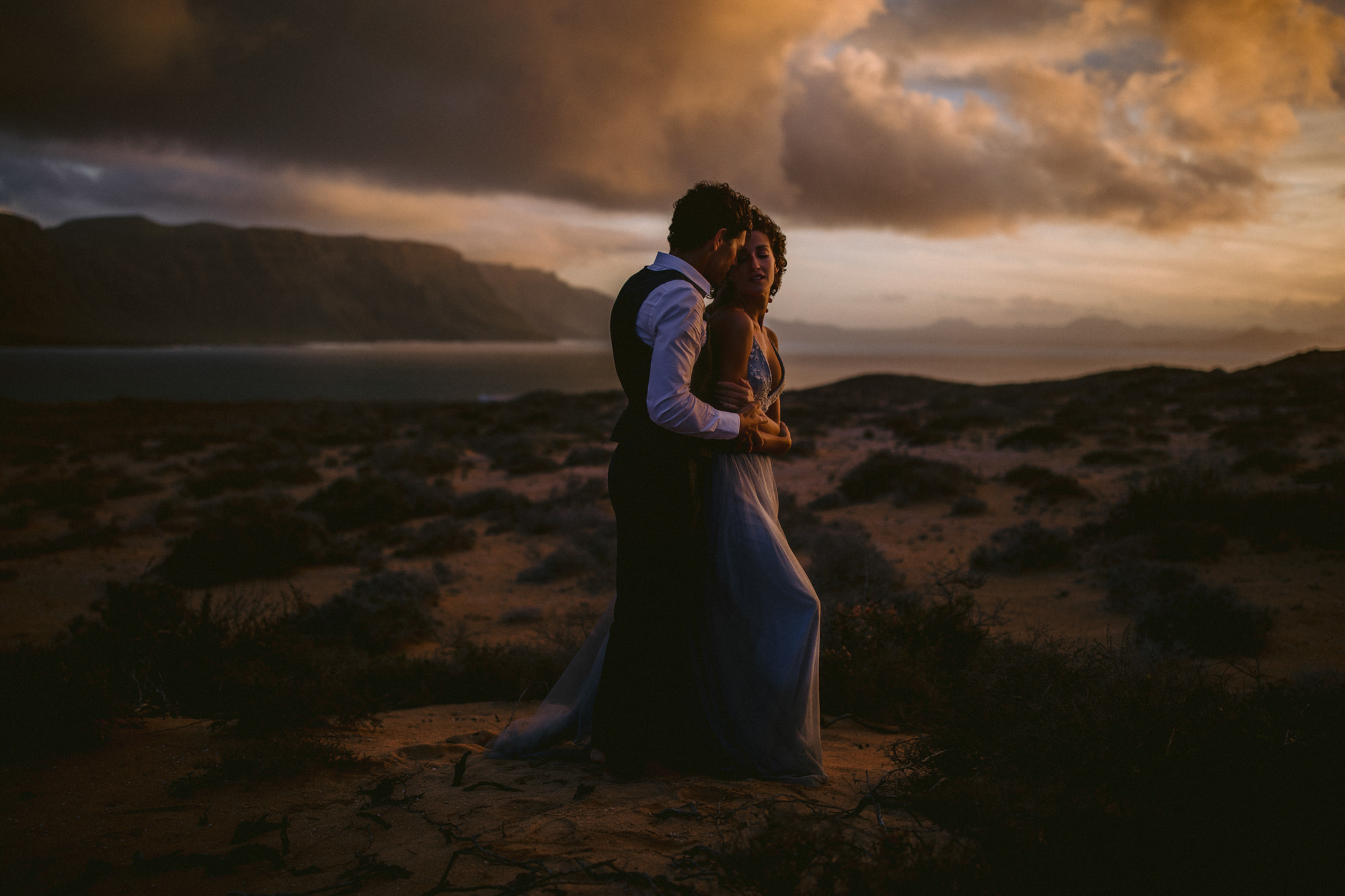 Moody couple portrait  amid sagebrush - photo by McClintock Photography Agency