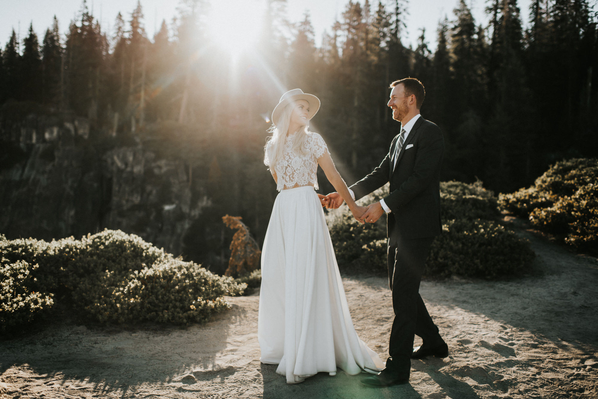 Sunlit couple bride with short applique top and long skirt - photo by Nick + Danee