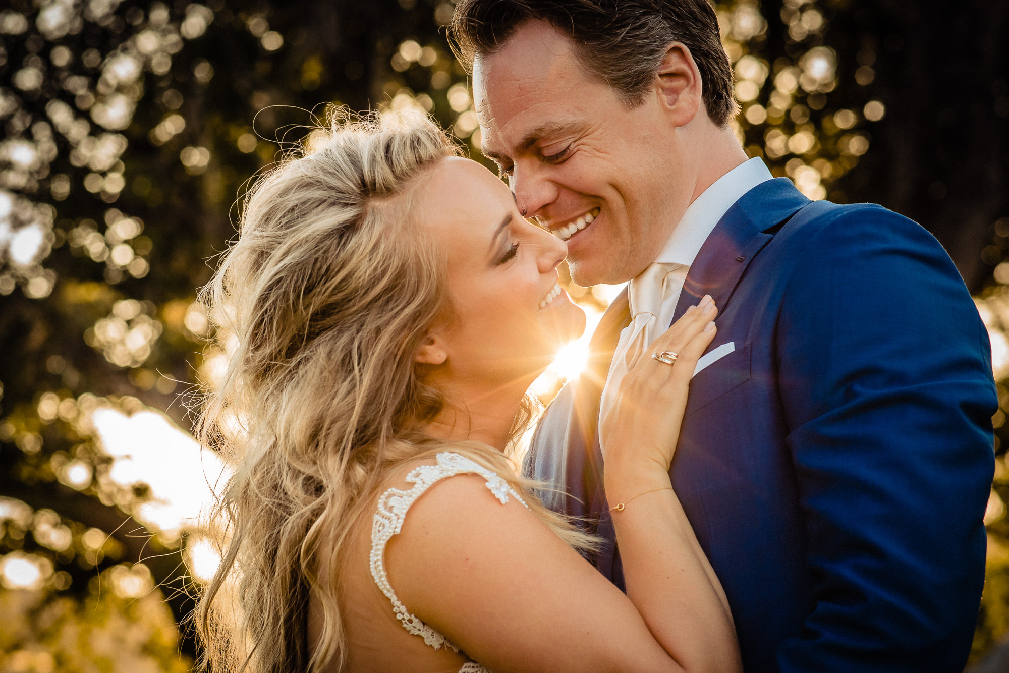 Sunlit candid portrait of happy bride and groom by Eppel Photography Netherlands