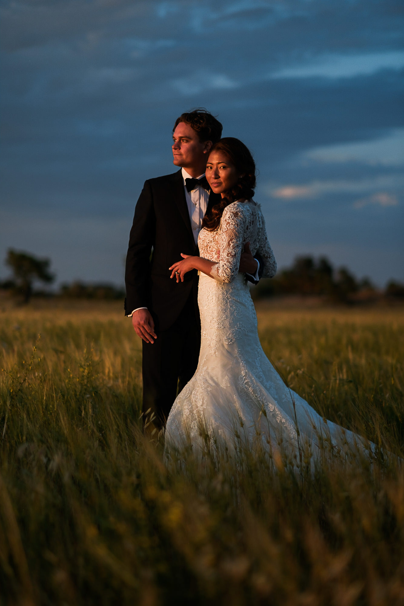 Sunset couple portrait in elegant lace long sleeve gown photo by Nordica Photography