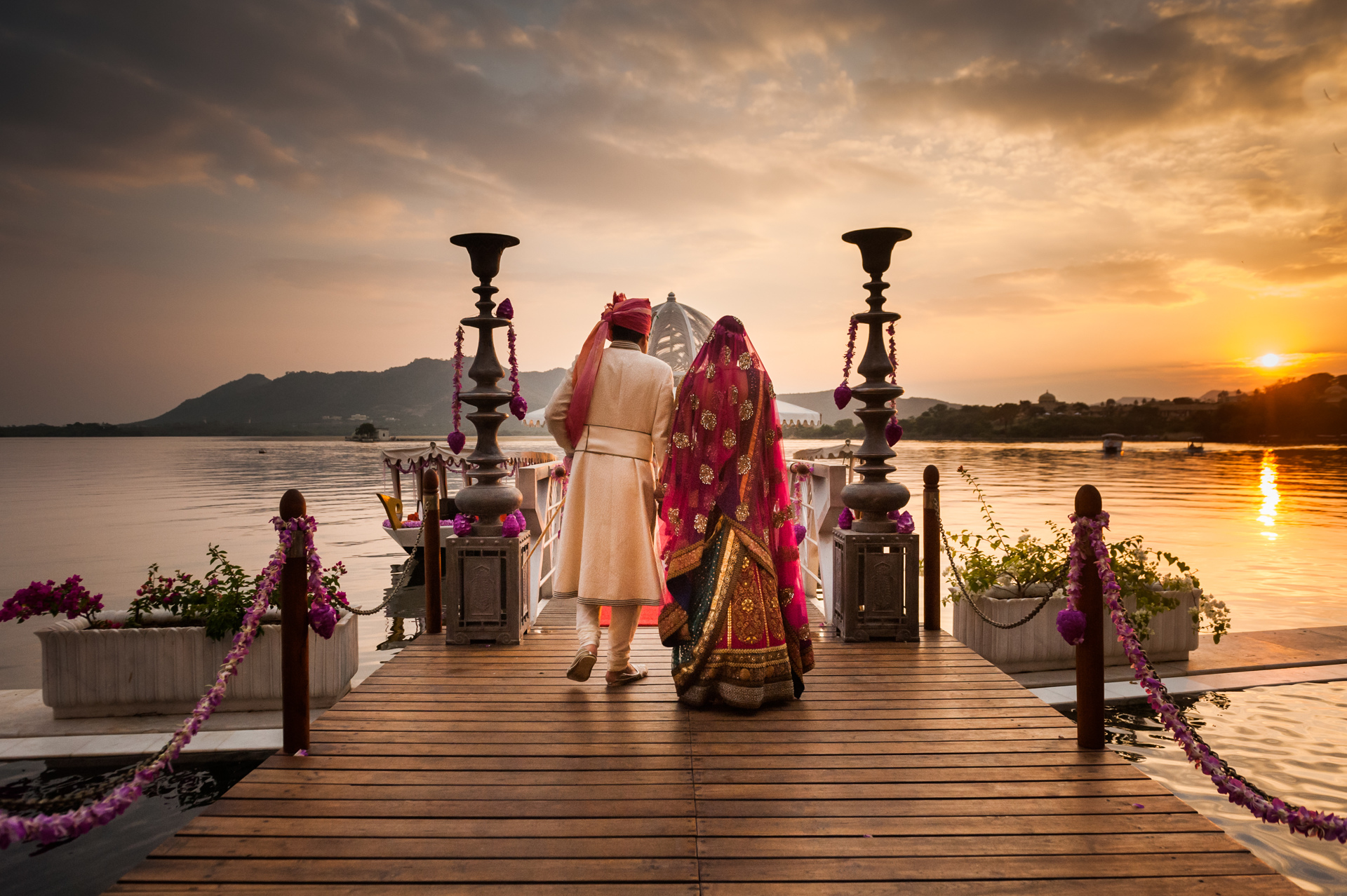 Couple in traditional Indian attire at sunset by Sephi Bergerson