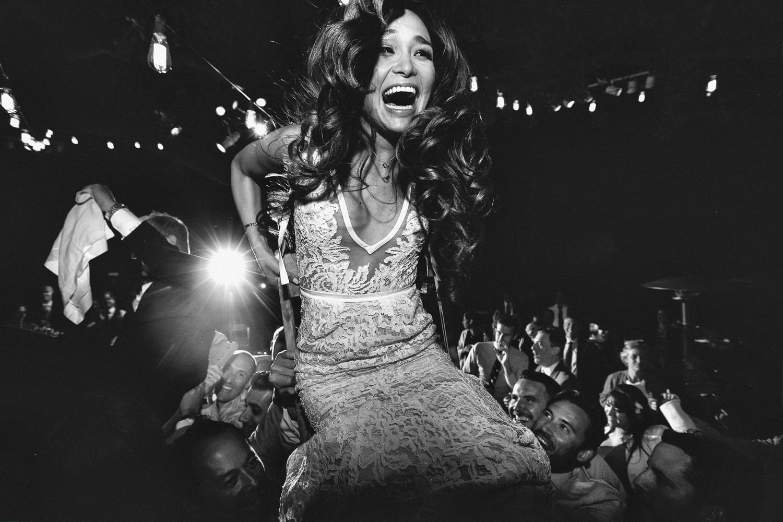 Bride laughing through horah, by Callaway Gable