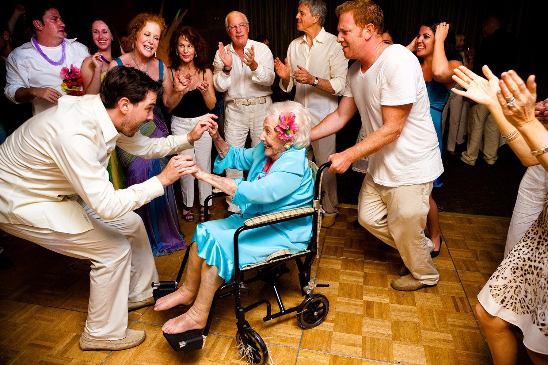 Sweet grandma in wheelchair dancing with groom, by Callaway Gable