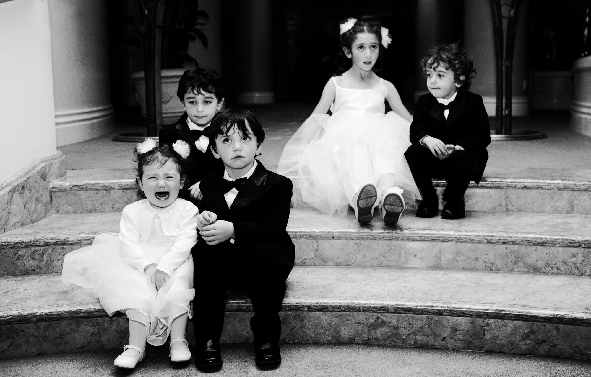 Adorable little girl crying with kids at wedding - photo by Roberto Valenzuela