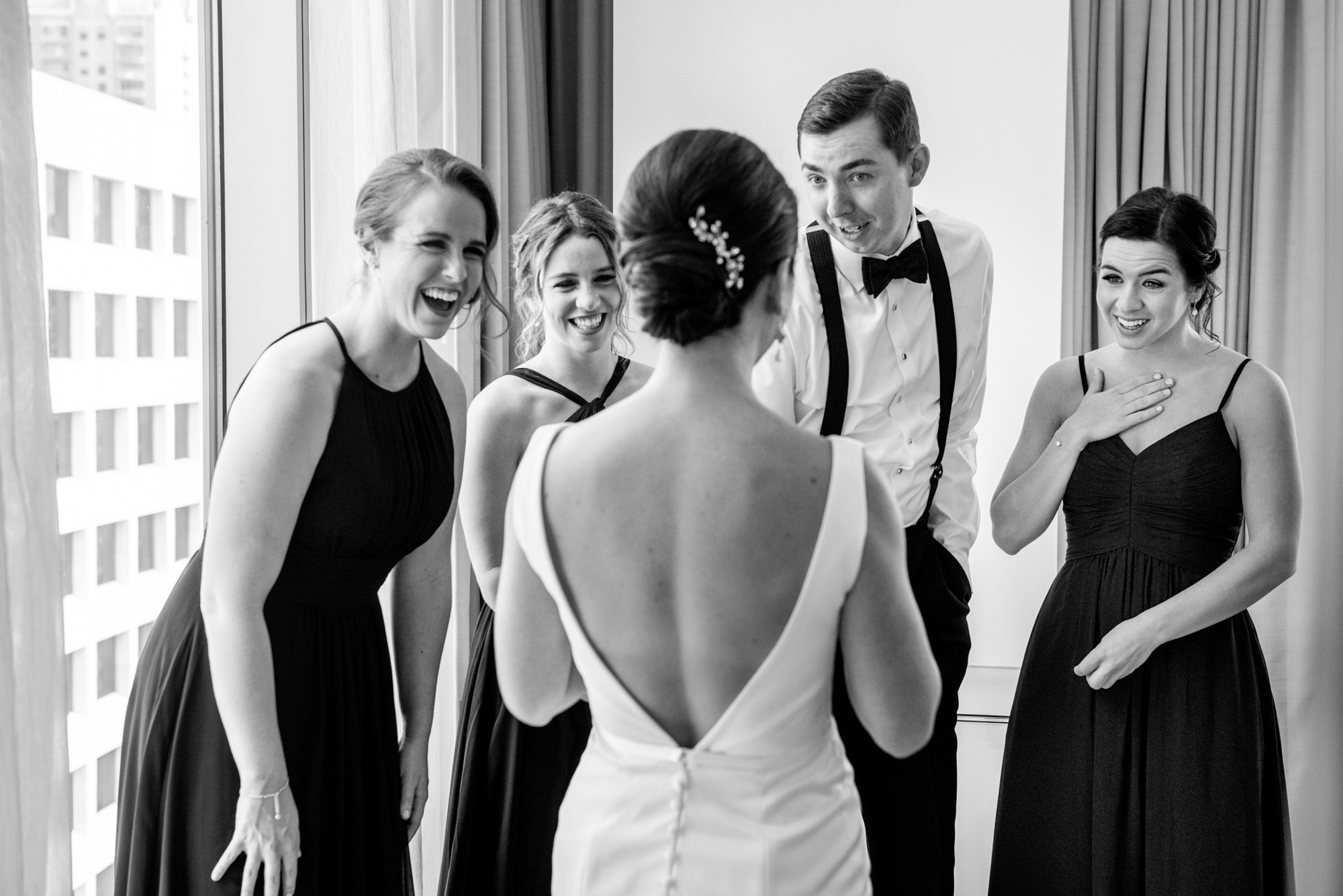 Friends respond to bride in her gown - Morgan Lynn Photography