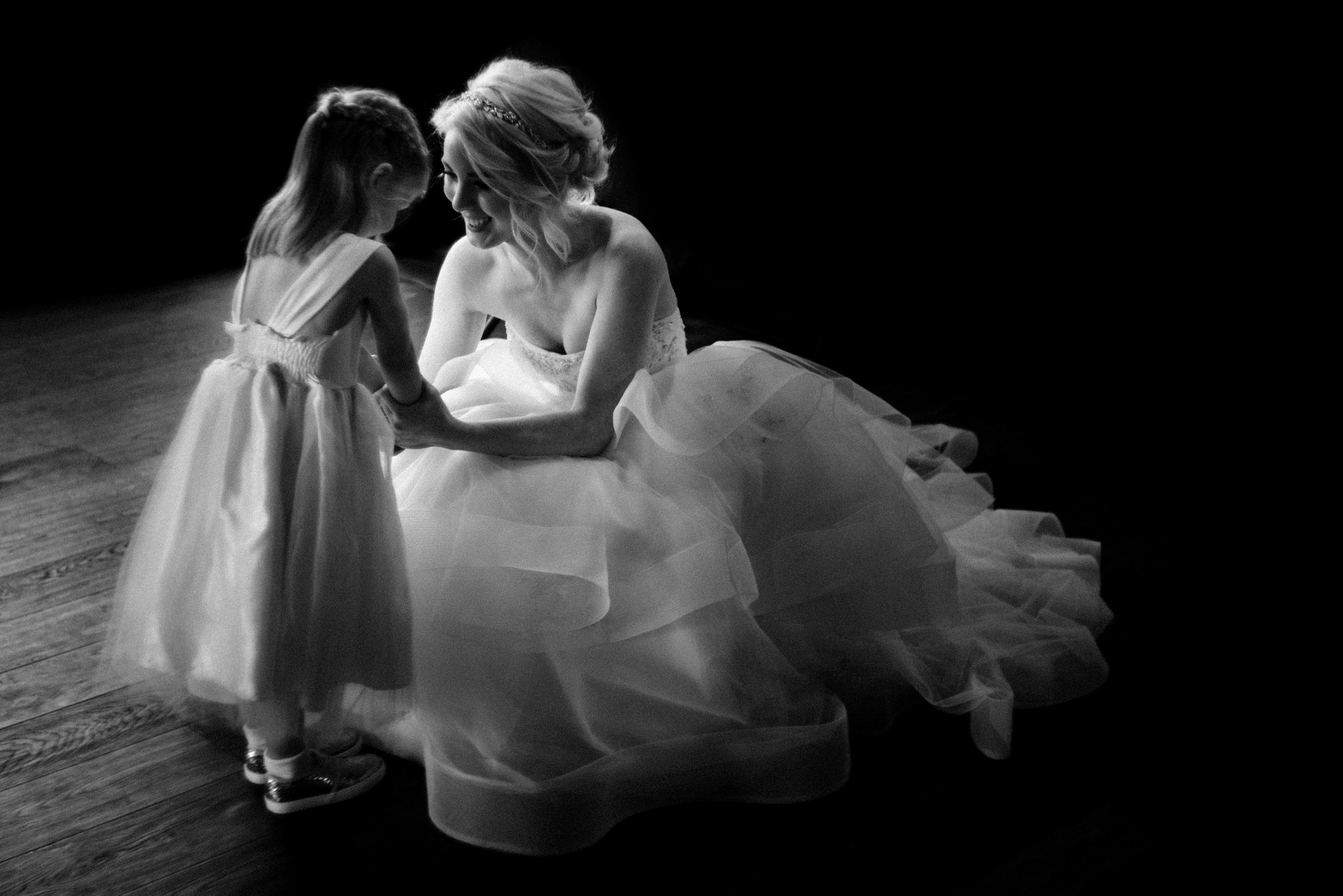 Bride holding hands with little girl - photo by John and Joseph - Los Angeles