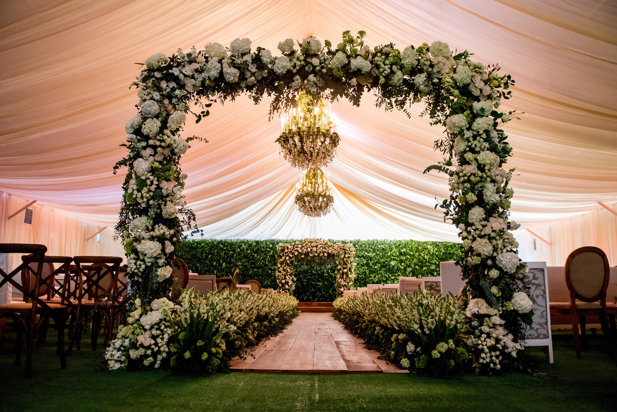 Ceremony decor with beautiful ornate arbors, by Morgan Lynn Razi