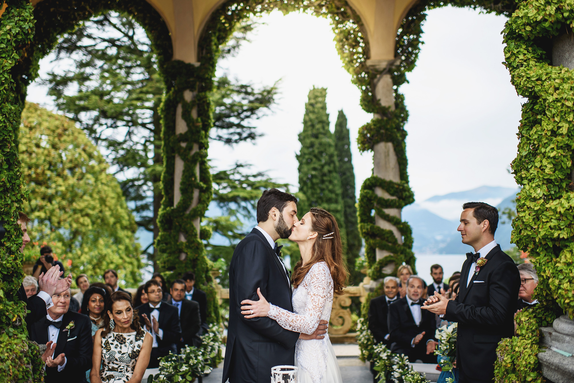Garden ceremony kiss at Lake Como - photo by Ross Harvey