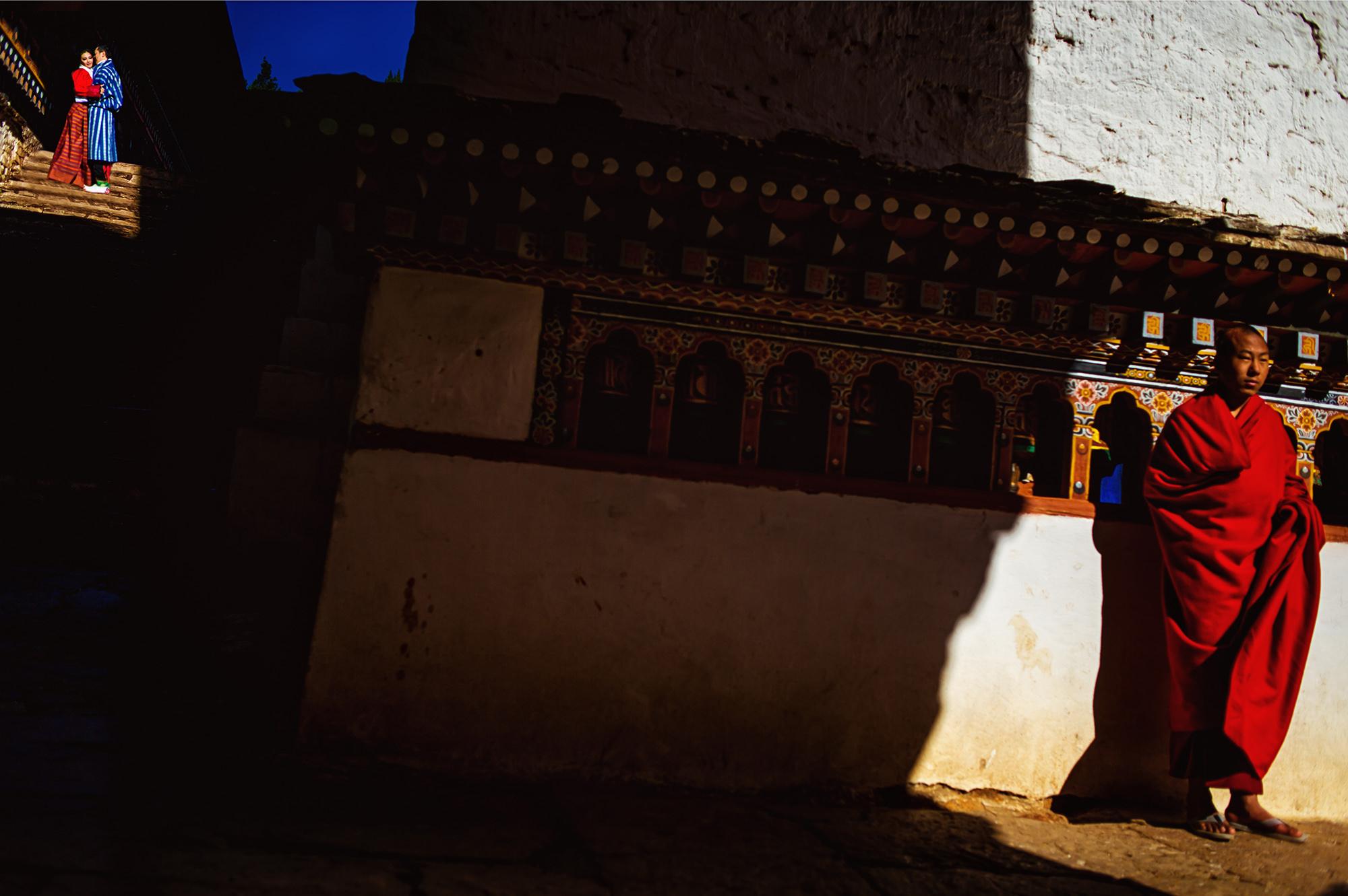 Tibetan monk juxtaposed against couple - Davina + Daniel