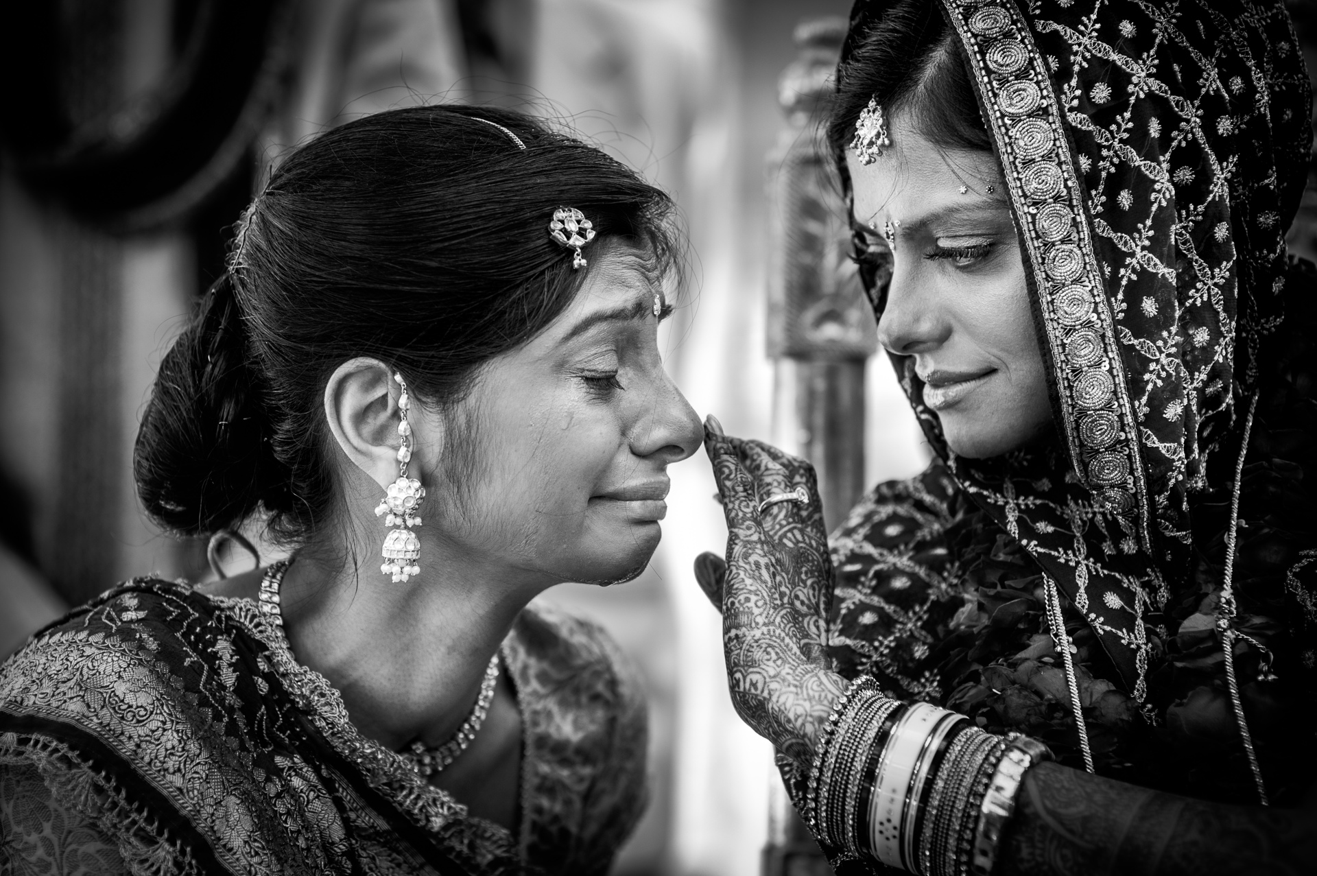 Bride comfots her mother - photo by Sephi Bergerson