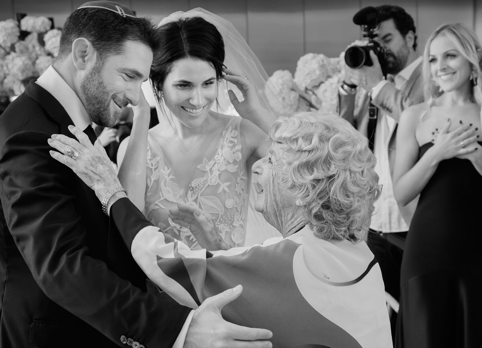 Touching photo of bride and groom greeting older guest  - photo by Marcus Bell