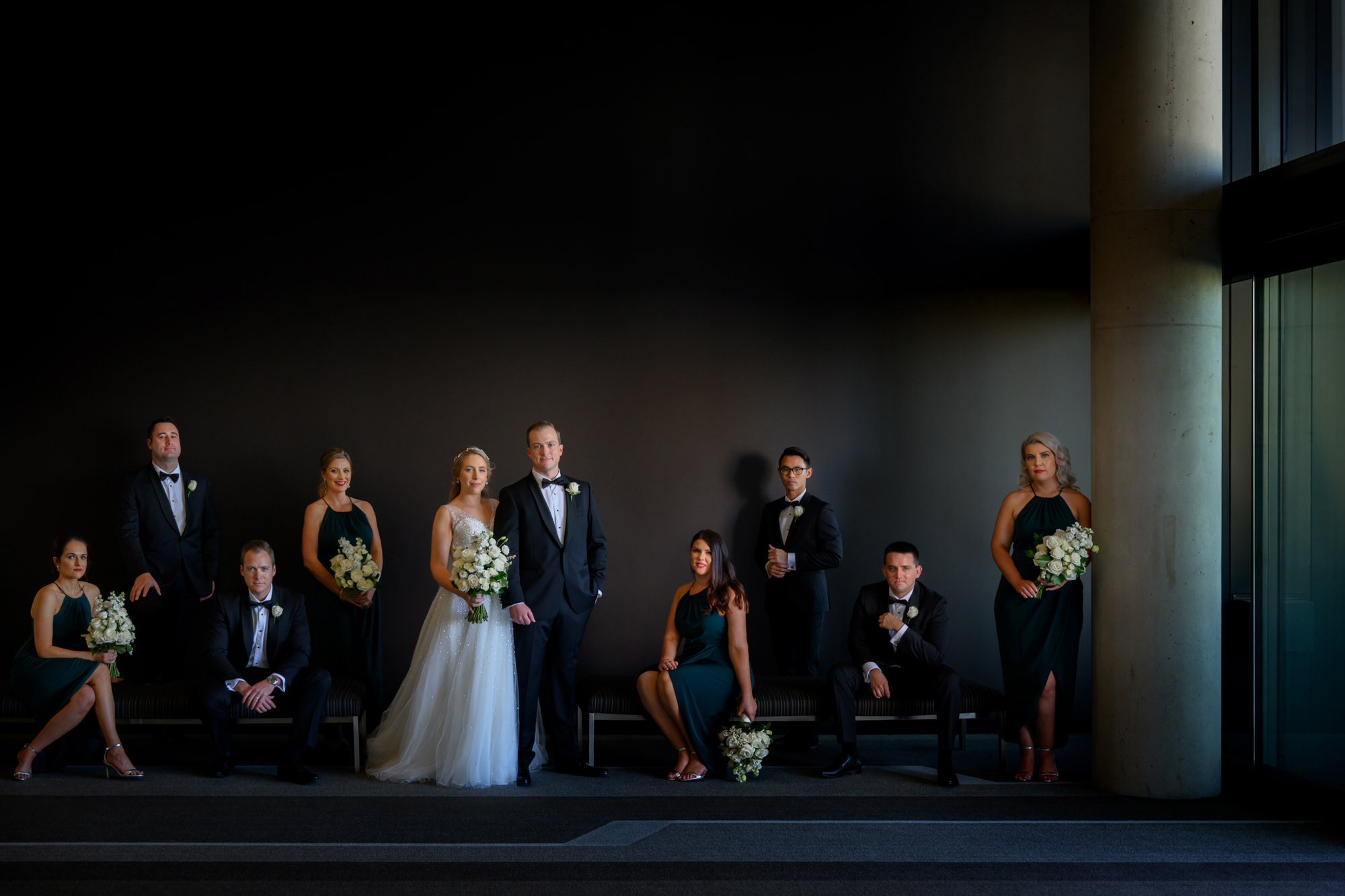 Traditional bridal party portrait with white bouquets - photo by Marcus Bell