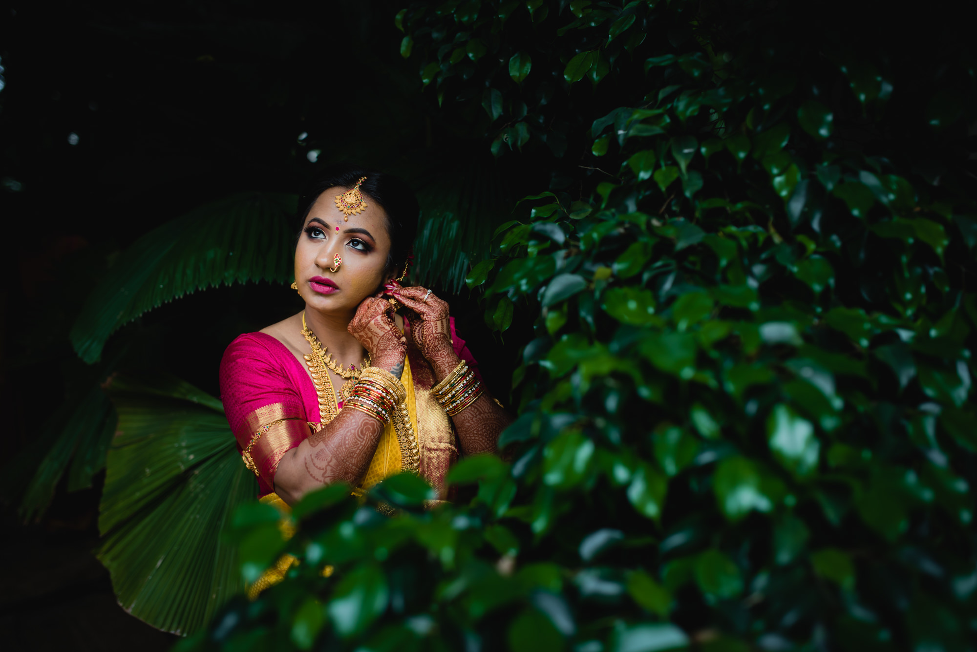 Traditional Indian bride in gold and henna photo by Rimi Sen