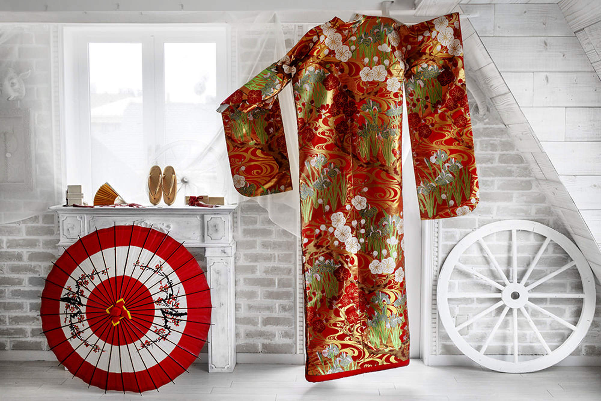 Beautiful red and gold kimono with umbrella and shoes