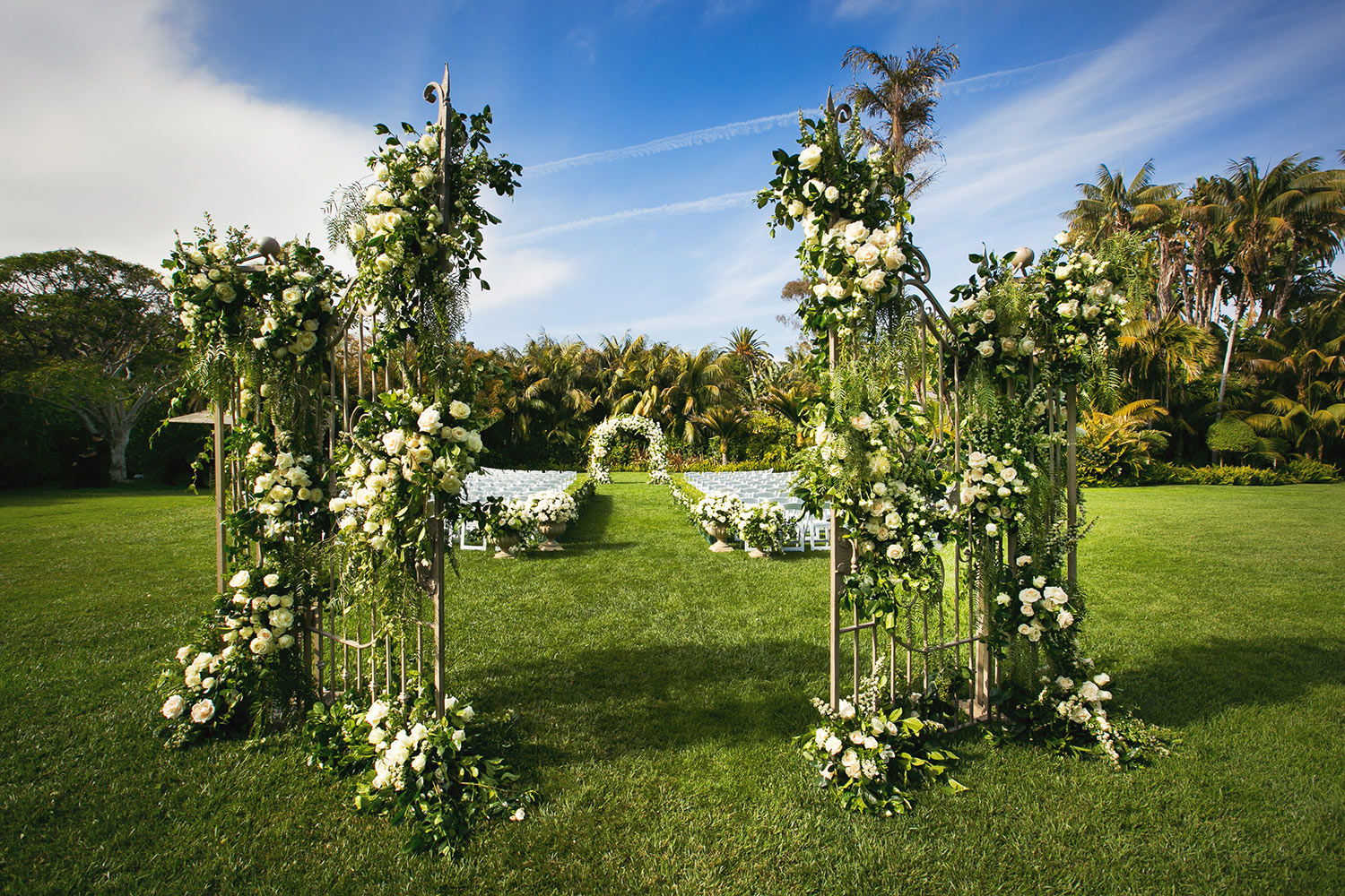 Ornate floral arch and gateway for tropical ceremony, by Callaway Gable