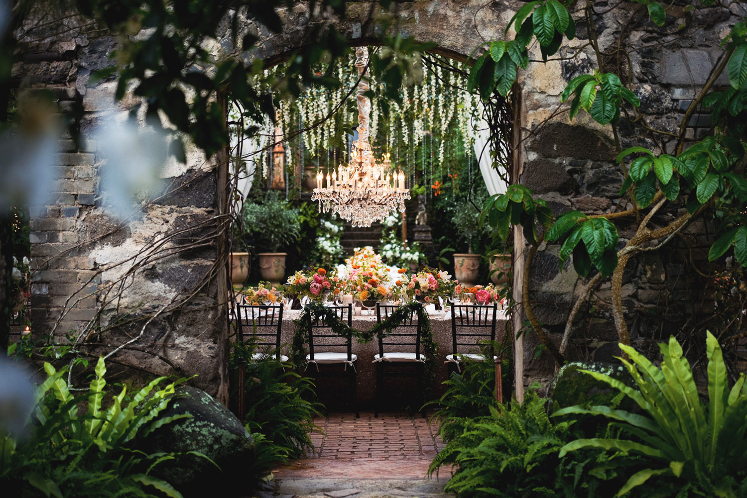 Colorful tropical reception tablescape, photo by Callaway Gable