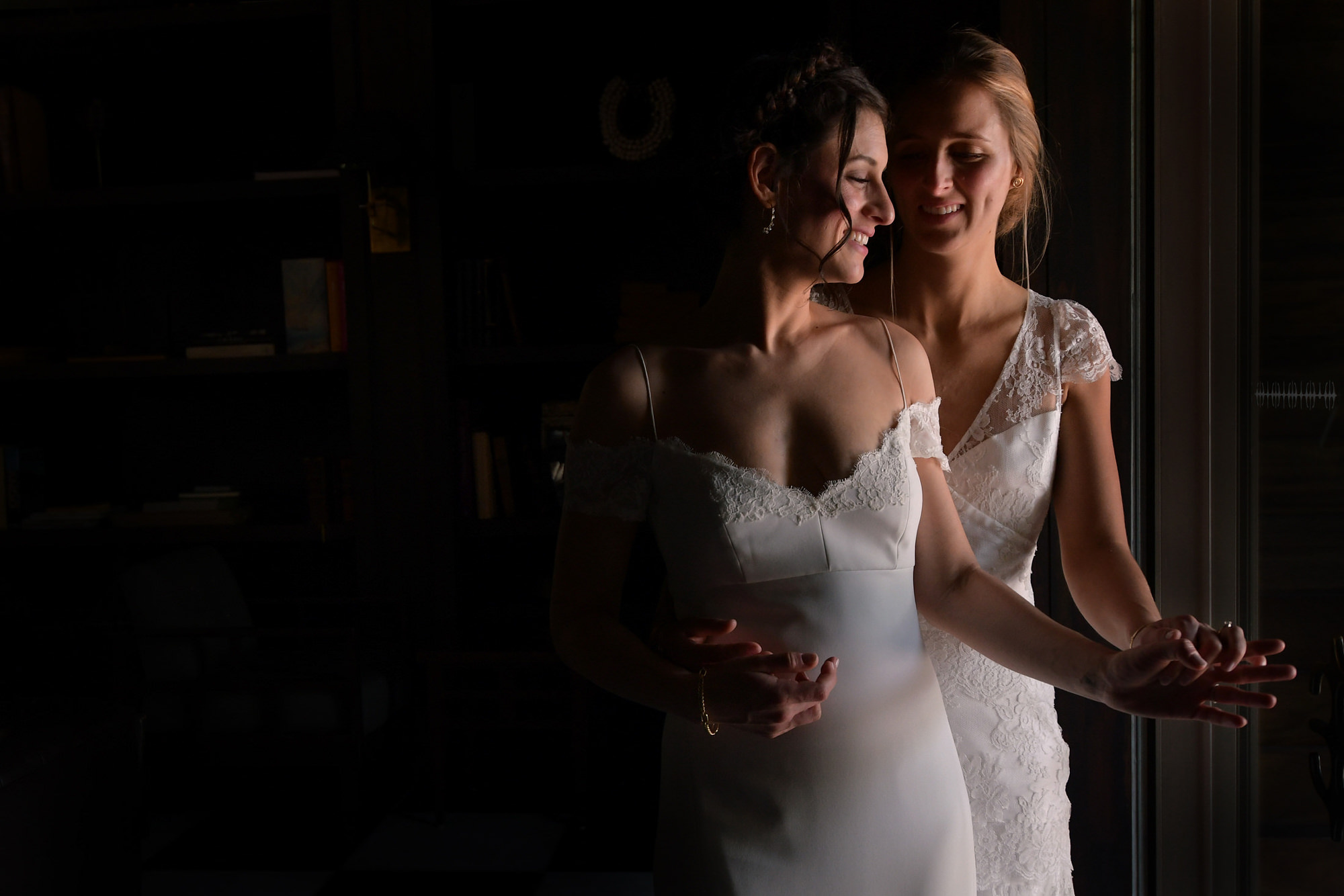 Bride holding bride in windowlight  - Daniel Aguilar Photographer